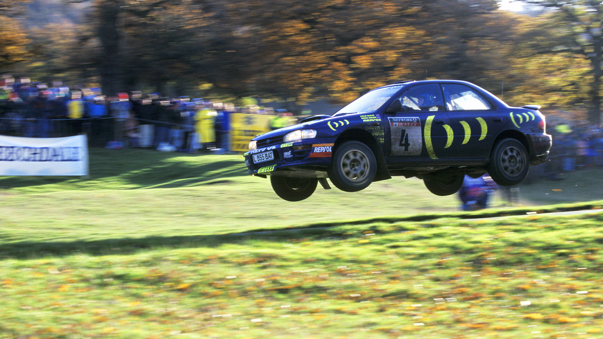 Subaru of Colin McRae in mid-air during the 1995 RAC Rally