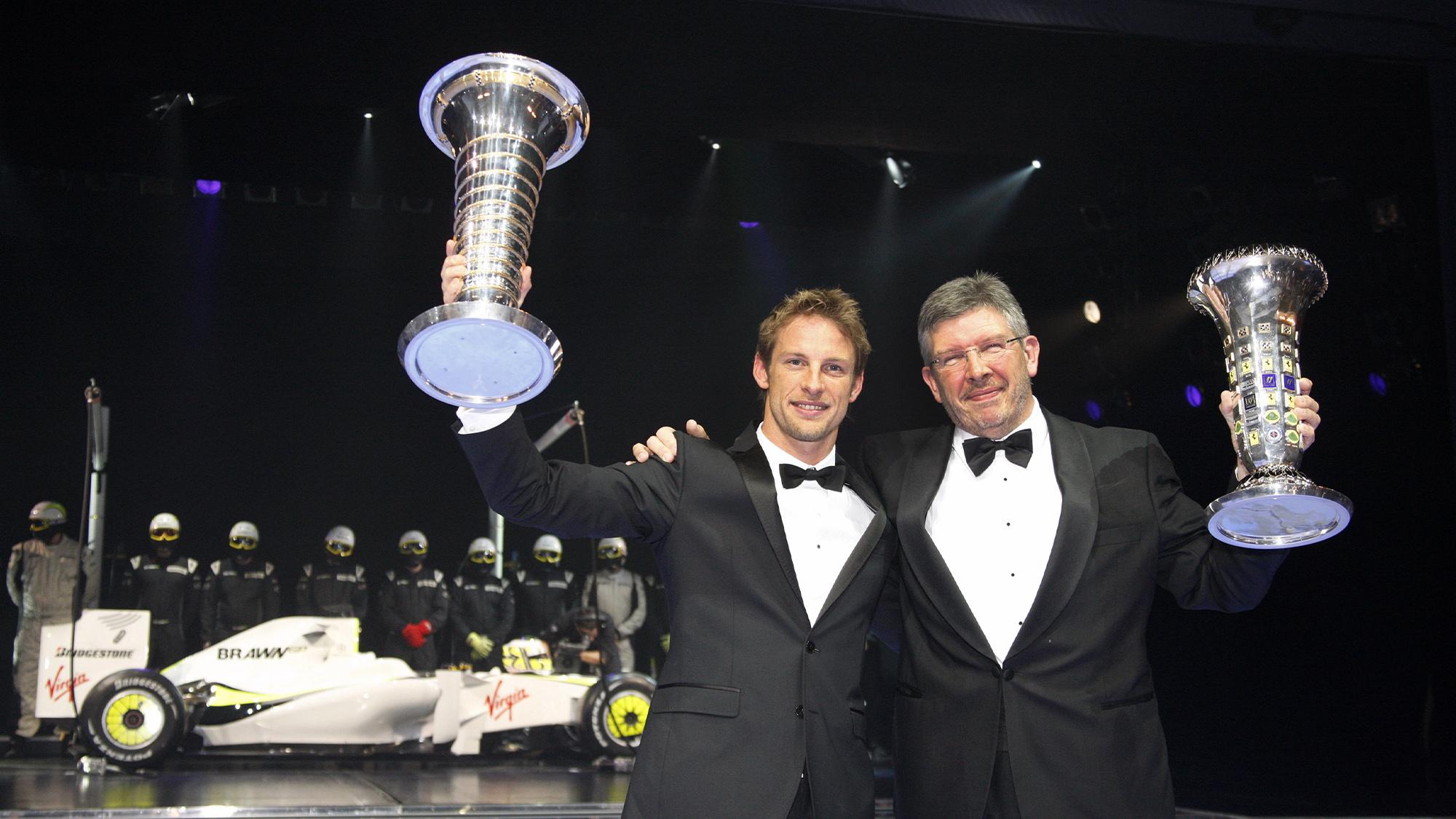 Jenson Button and Ross Brawn celebrate winning the 2009 F1 championships