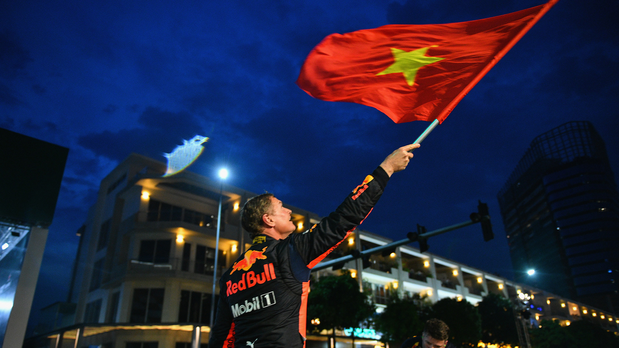 David Coulthard waves the Vietnamese Flag in Ho Chi Minh City