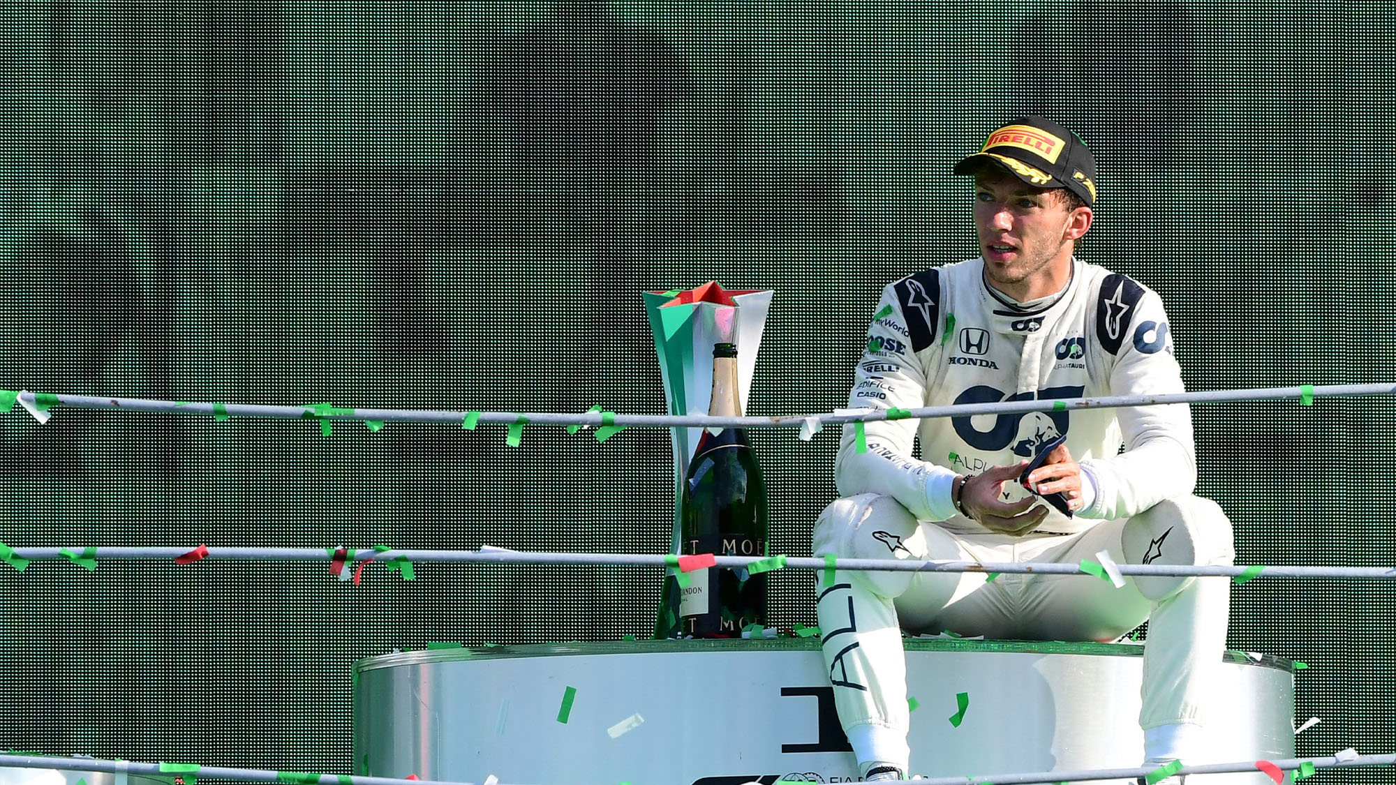 Winner AlphaTauri's French driver Pierre Gasly reacts on the podium after the Italian Formula One Grand Prix at the Autodromo Nazionale circuit in Monza on September 6, 2020. (Photo by JENNIFER LORENZINI / POOL / AFP) (Photo by JENNIFER LORENZINI/POOL/AFP via Getty Images)