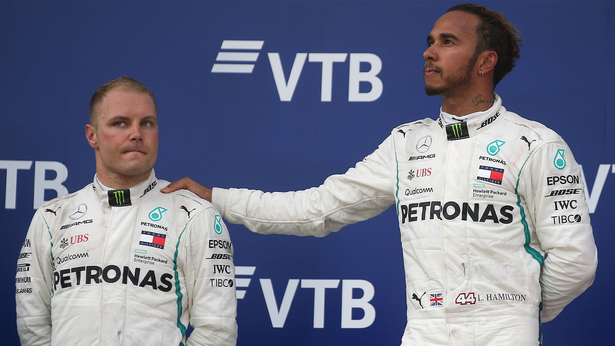 SOCHI, RUSSIA SEPTEMBER 30, 2018: Mercedes AMG Petronas drivers Valtteri Bottas (L) of Finland, second-placed, and Lewis Hamilton (L-R) of the United Kingdom, first-placed, attend the 2018 Formula One Russian Grand Prix awarding ceremony at the Sochi Autodrom racing circuit. Yegor Aleyev/TASS (Photo by Yegor Aleyev\TASS via Getty Images)