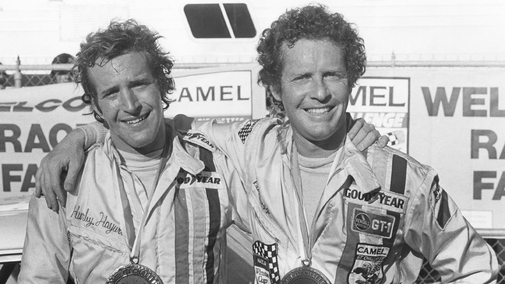 DAYTONA BEACH, FL — Mid-1970s: Peter Gregg (L) and Hurley Haywood (R) co-drove a Porsche 911 to victory in the 24 Hours of Daytona at Daytona International Speedway in both 1973 and 1975. (Photo by ISC Images & Archives via Getty Images)