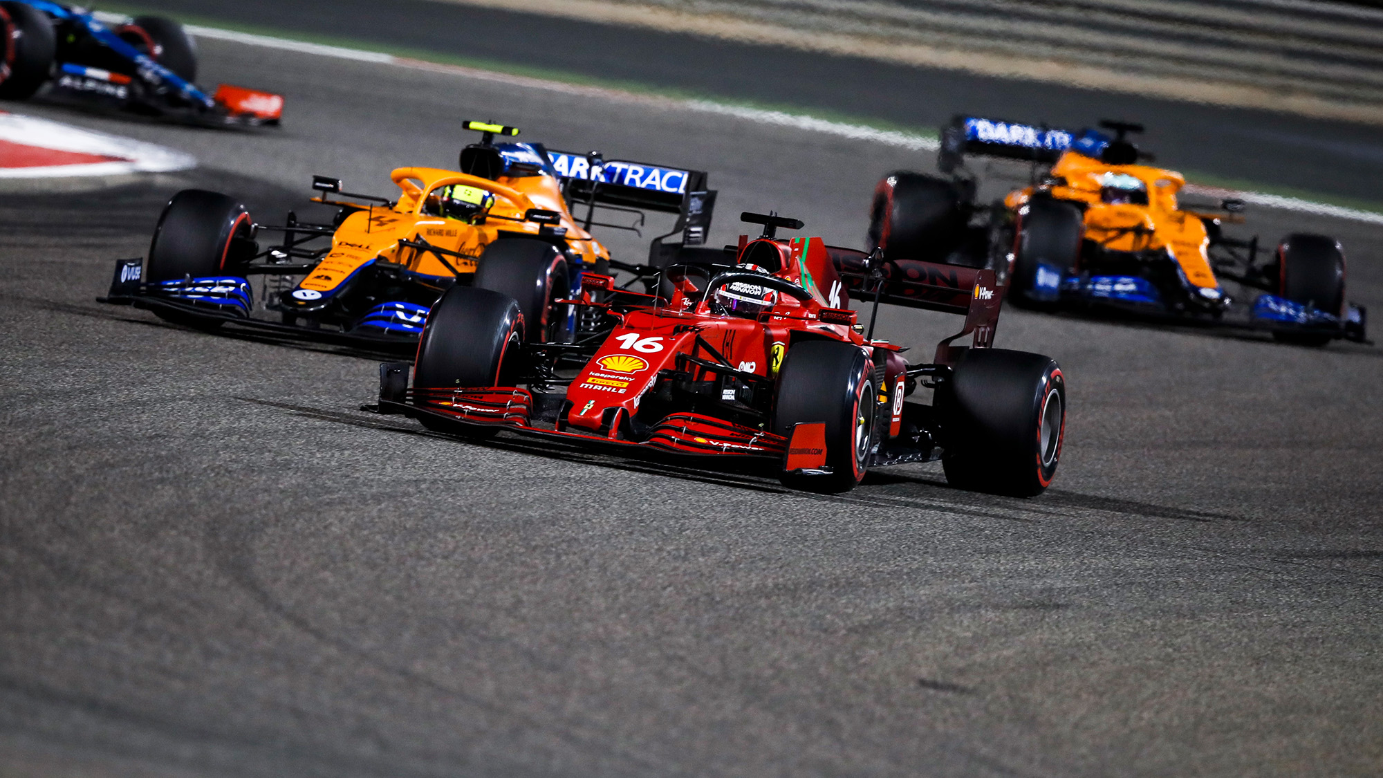 Charles Leclerc and Lando Norris in the 2021 Bahrain Grand Prix