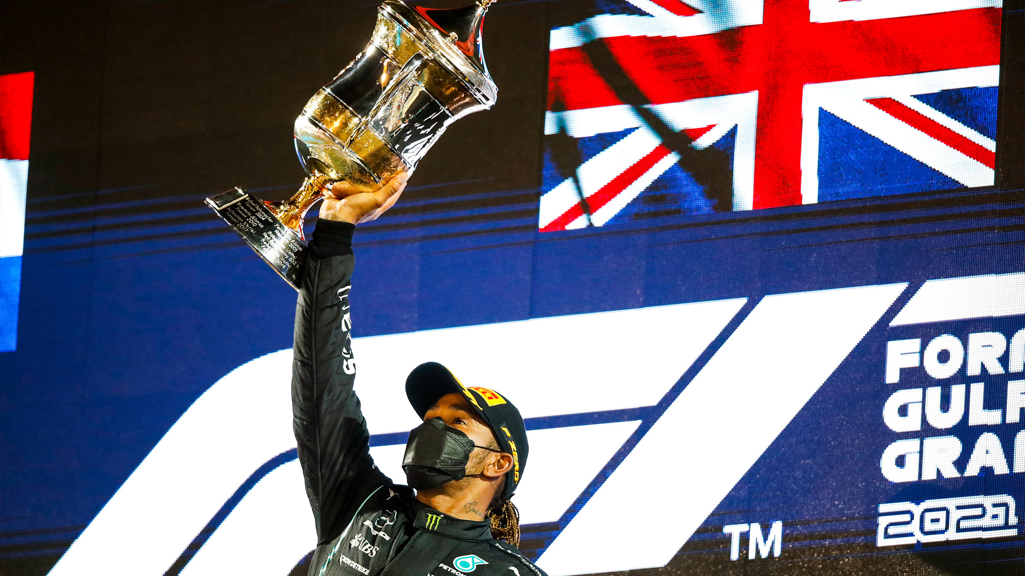 Lewis Hamilton lifts the winners trophy from the 2021 Bahrain Grand Prix