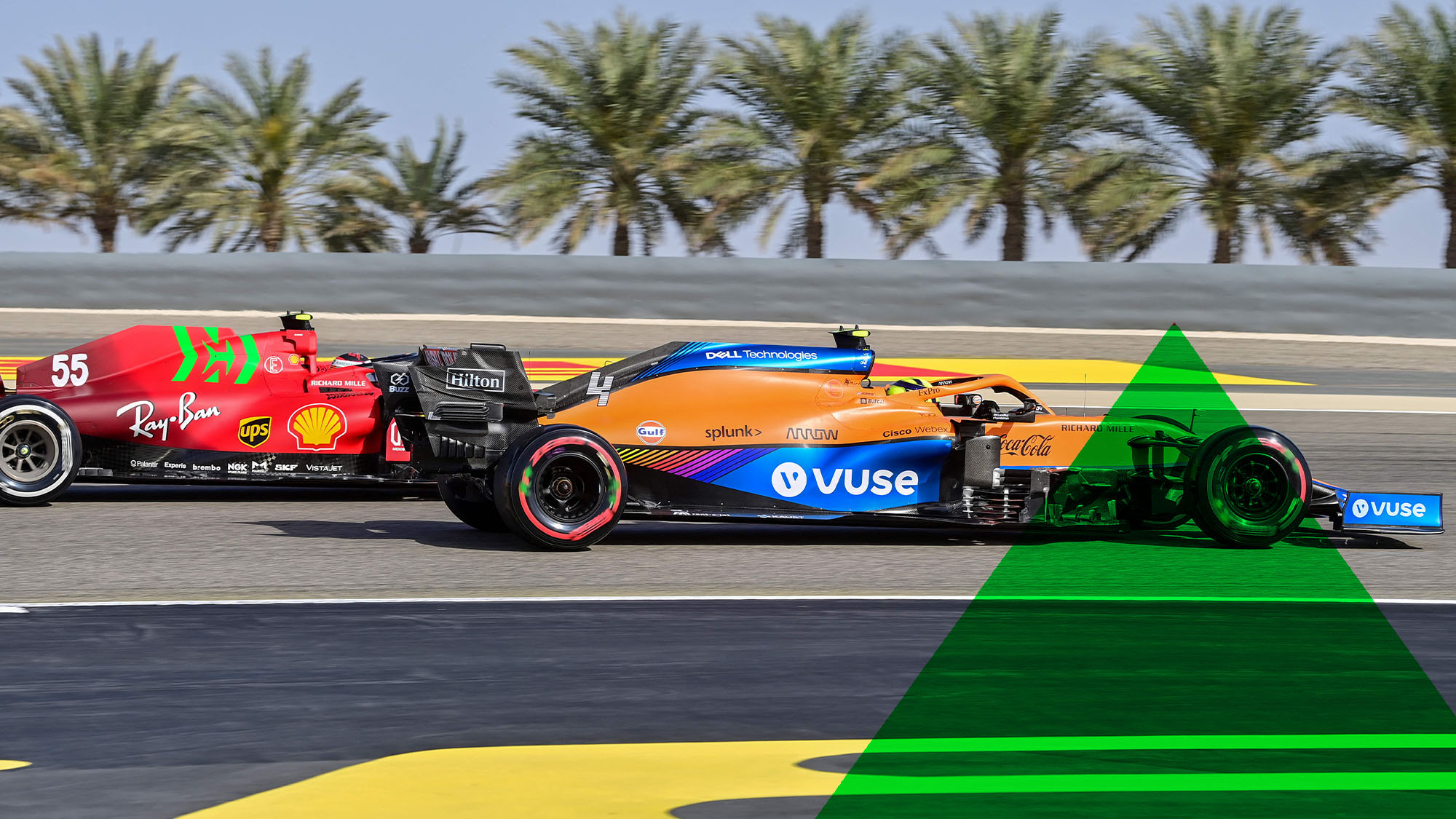Ferrari's Spanish driver Carlos Sainz Jr (L) and McLaren's British driver Lando Norris vie for position during the third practice session ahead of the Bahrain Formula One Grand Prix at the Bahrain International Circuit in the city of Sakhir on March 27, 2021. (Photo by ANDREJ ISAKOVIC / AFP) (Photo by ANDREJ ISAKOVIC/AFP via Getty Images)