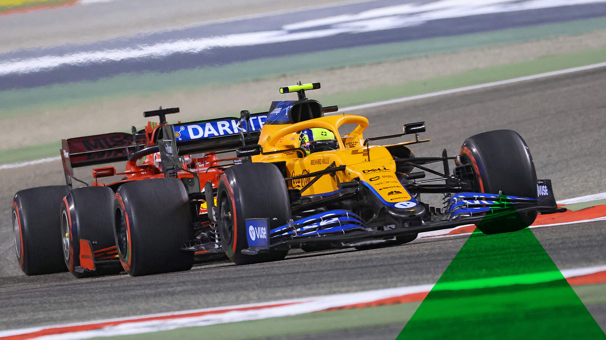 McLaren's British driver Lando Norris vies for position with Ferrari's Monegasque driver Charles Leclerc during the Bahrain Formula One Grand Prix at the Bahrain International Circuit in the city of Sakhir on March 28, 2021. (Photo by Giuseppe CACACE / AFP) (Photo by GIUSEPPE CACACE/AFP via Getty Images)