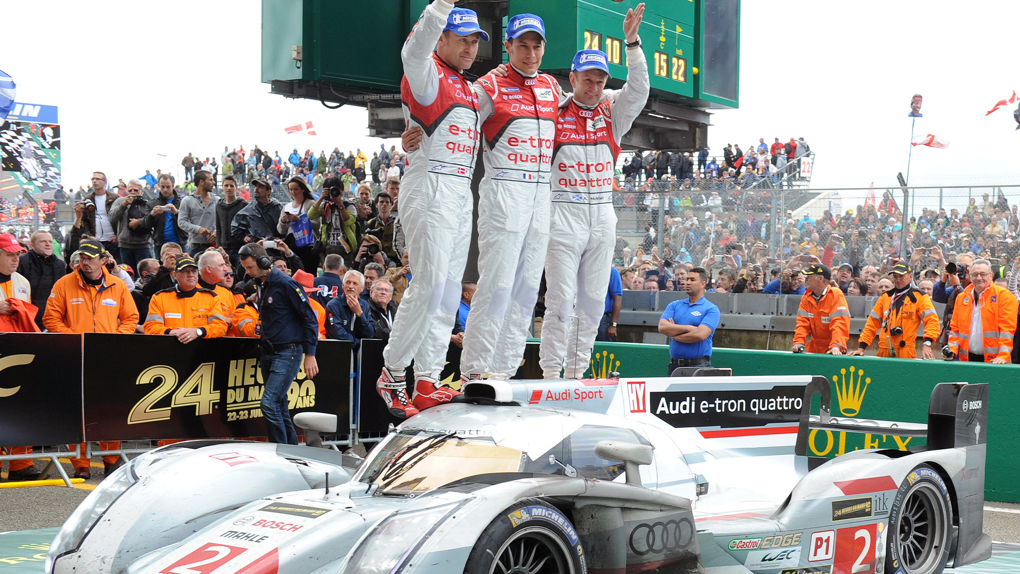 Tom Kristensen Loic Duval and Allan McNish celebrate winning the 2013 Le Mans 24 Hours