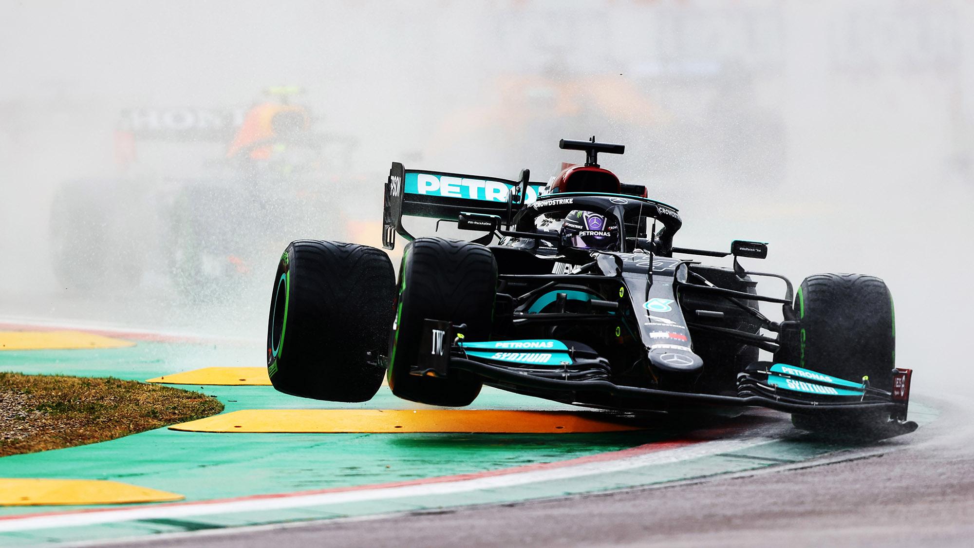 Lewis Hamilton crashes down onto a kerb at the start of the 2021 Emilia Romagna Grand Prix