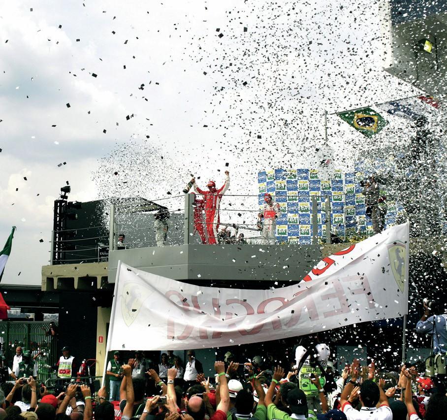 Kimi Raikkonen celebrates winning the 2007 Brazilian Grand Prix and the World Championship