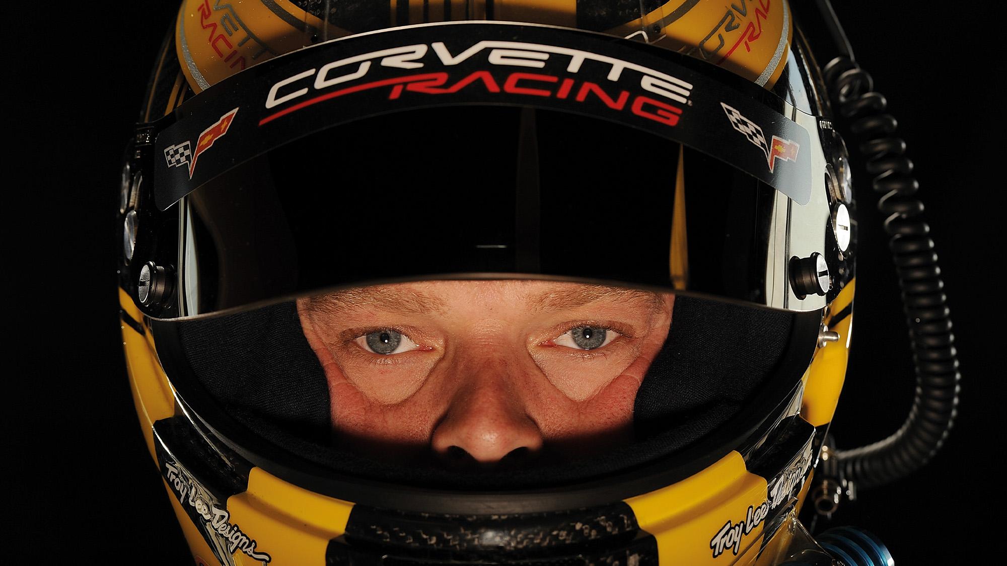 Eyes of Jan Magnussen inside his crash helmet