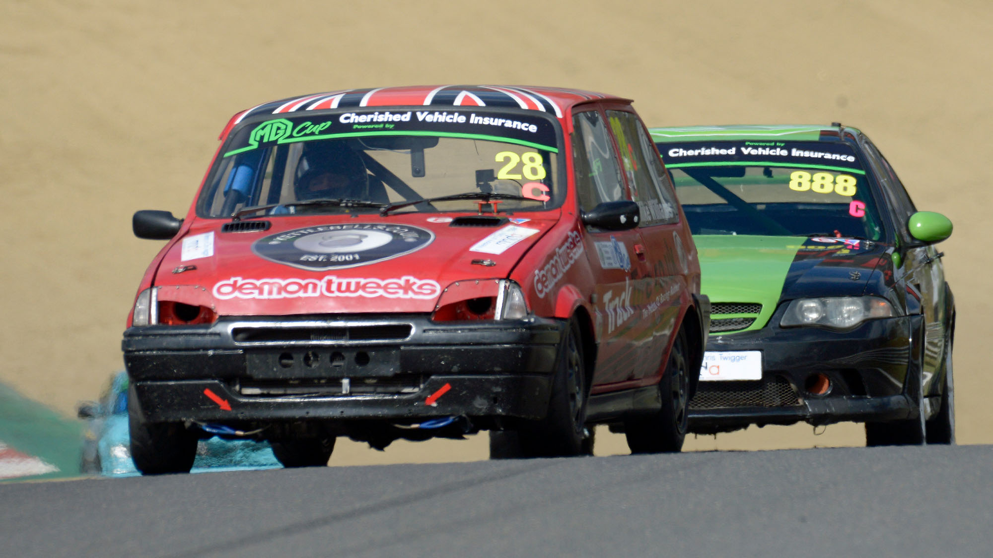 Mike Williams's effective 1.8 Metro heads the MG ZS of Morgan Short – son of veteran racer Martin – on his way to the first of two MG Cup wins at Brands Hatch