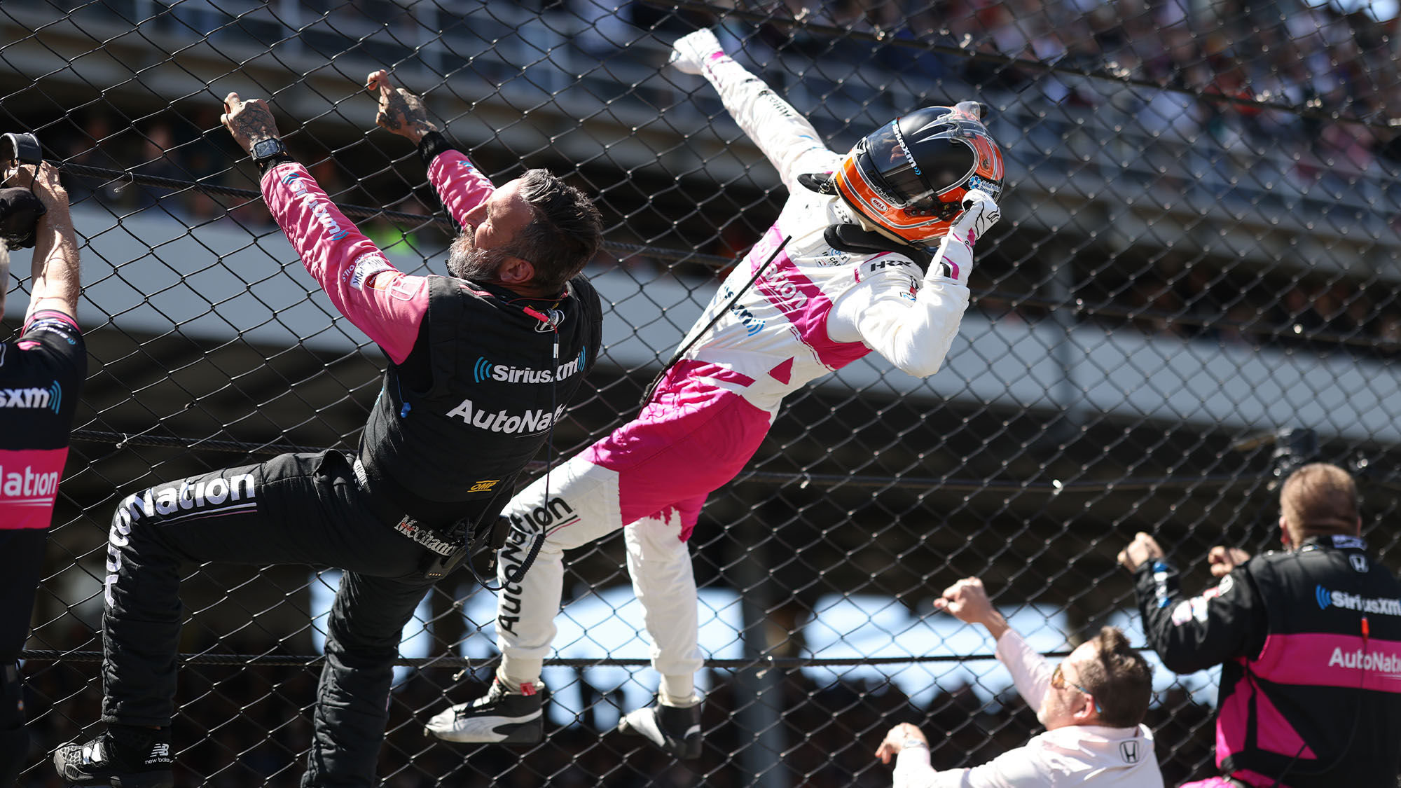 Castroneves climbs fence after winning Indy 500