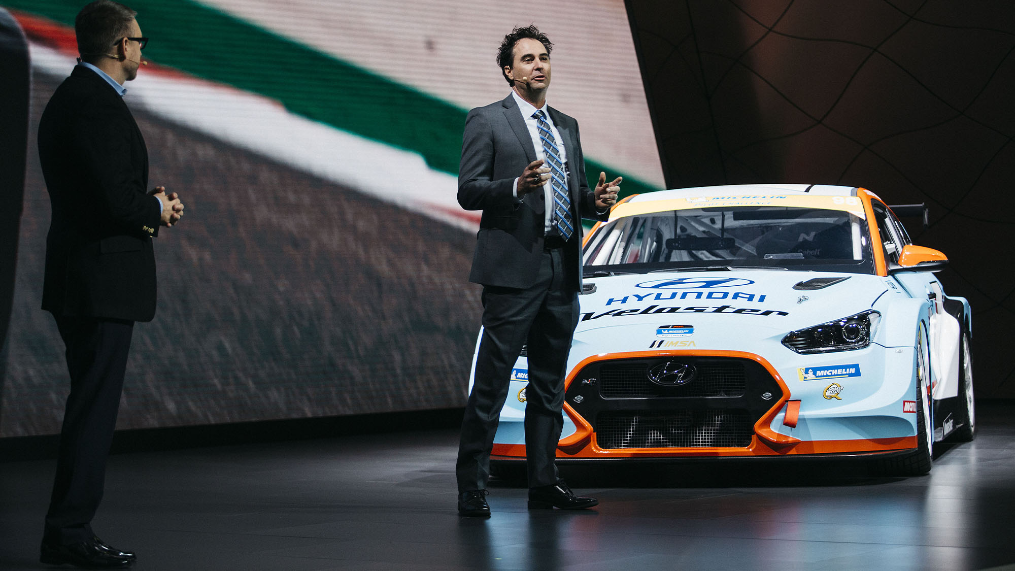 Bryan Herta, president and co-owner of Bryan Herta Autosport, speaks while standing next to the Hyundai Motor Co. Veloster N TCR race car during the 2019 North American International Auto Show (NAIAS) in Detroit, Michigan, U.S., on Monday, Jan. 14, 2019. With the largest concentration of top automotive and technology executives, designers, engineers and thought leaders, the NAIAS serves as the global stage for companies to debut brand-defining vehicles and industry-shaping announcements. Photographer: Sean Proctor/Bloomberg via Getty Images