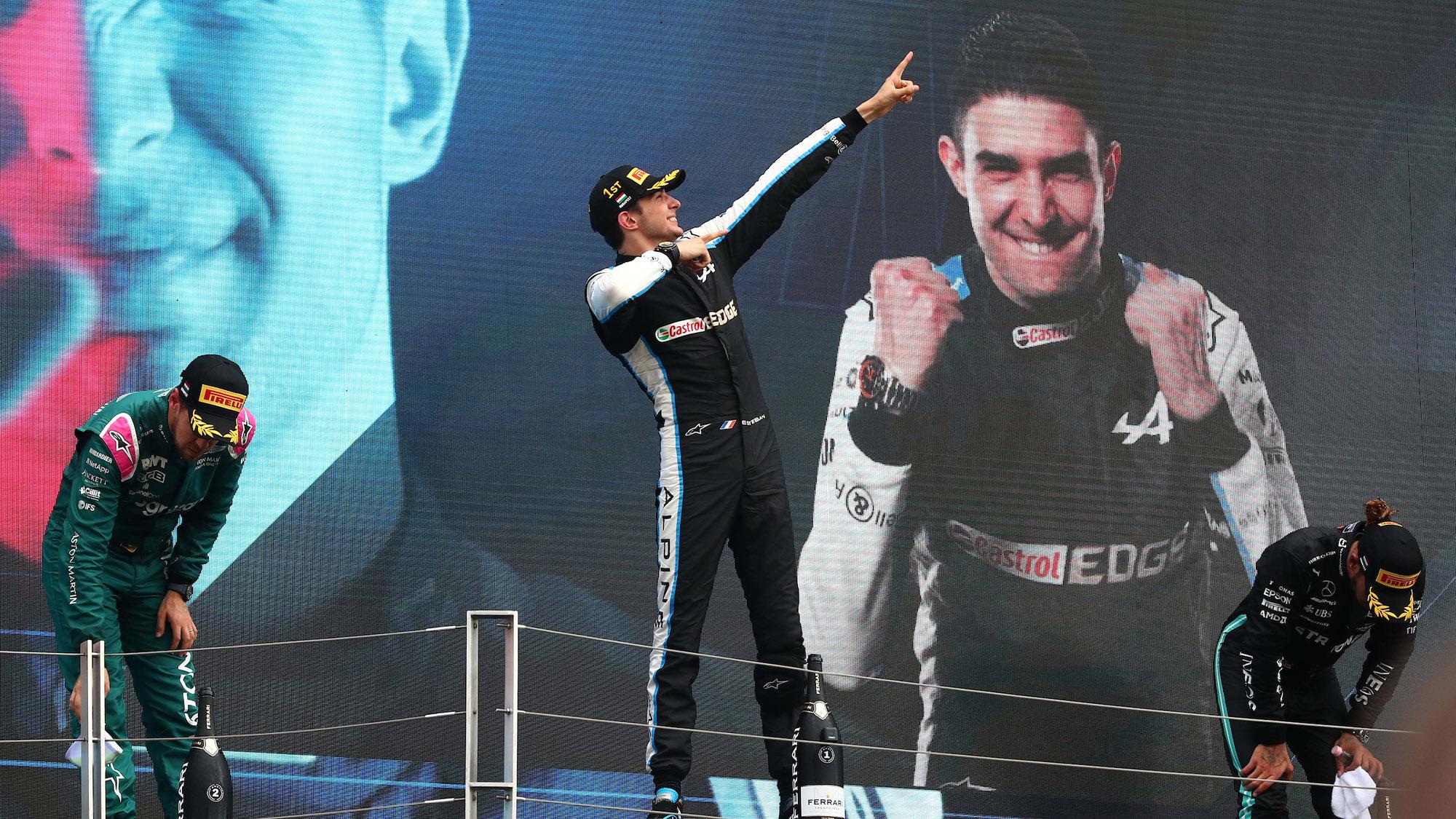 Esteban Ocon on the podium after winning the 2021 Hungarian Grand Prix