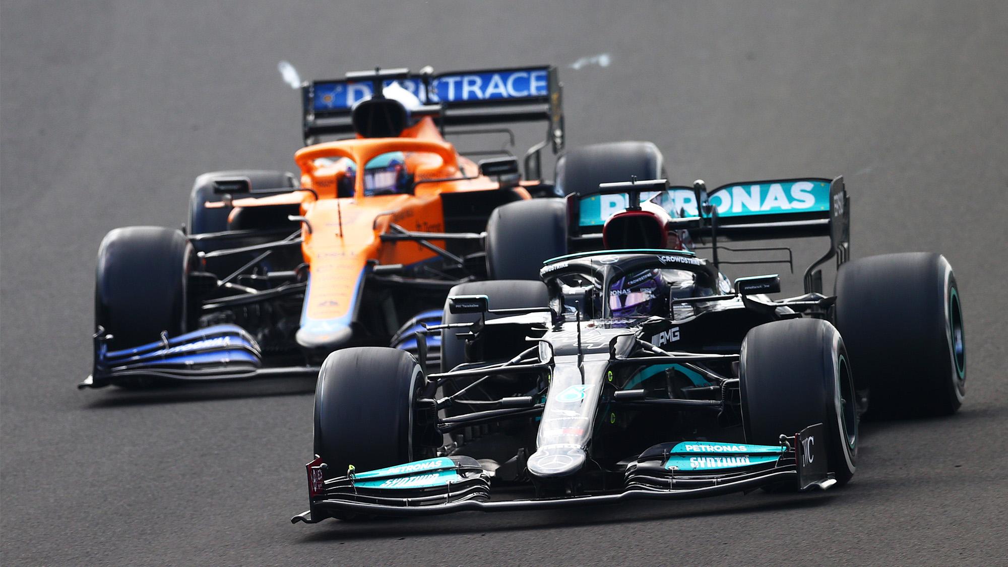 Lewis Hamilton overtakes Daniel Ricciardo at the 2021 Hungarian Grand Prix