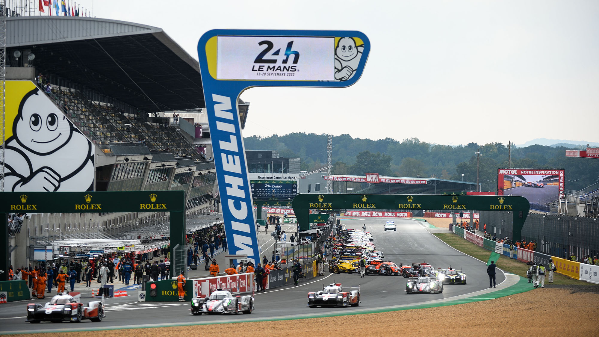 Drivers leave the pit lane for the warm up lap prior to the start of the 88th edition of the Le Mans 24 Hours race on September 19, 2020 at the La Sarthe circuit in Le Mans, in front of empty stands with Covid-19 keeping away the motorsport classic's normal crowd of 250,000 diehard fans. (Photo by JEAN-FRANCOIS MONIER / AFP) (Photo by JEAN-FRANCOIS MONIER/AFP via Getty Images)