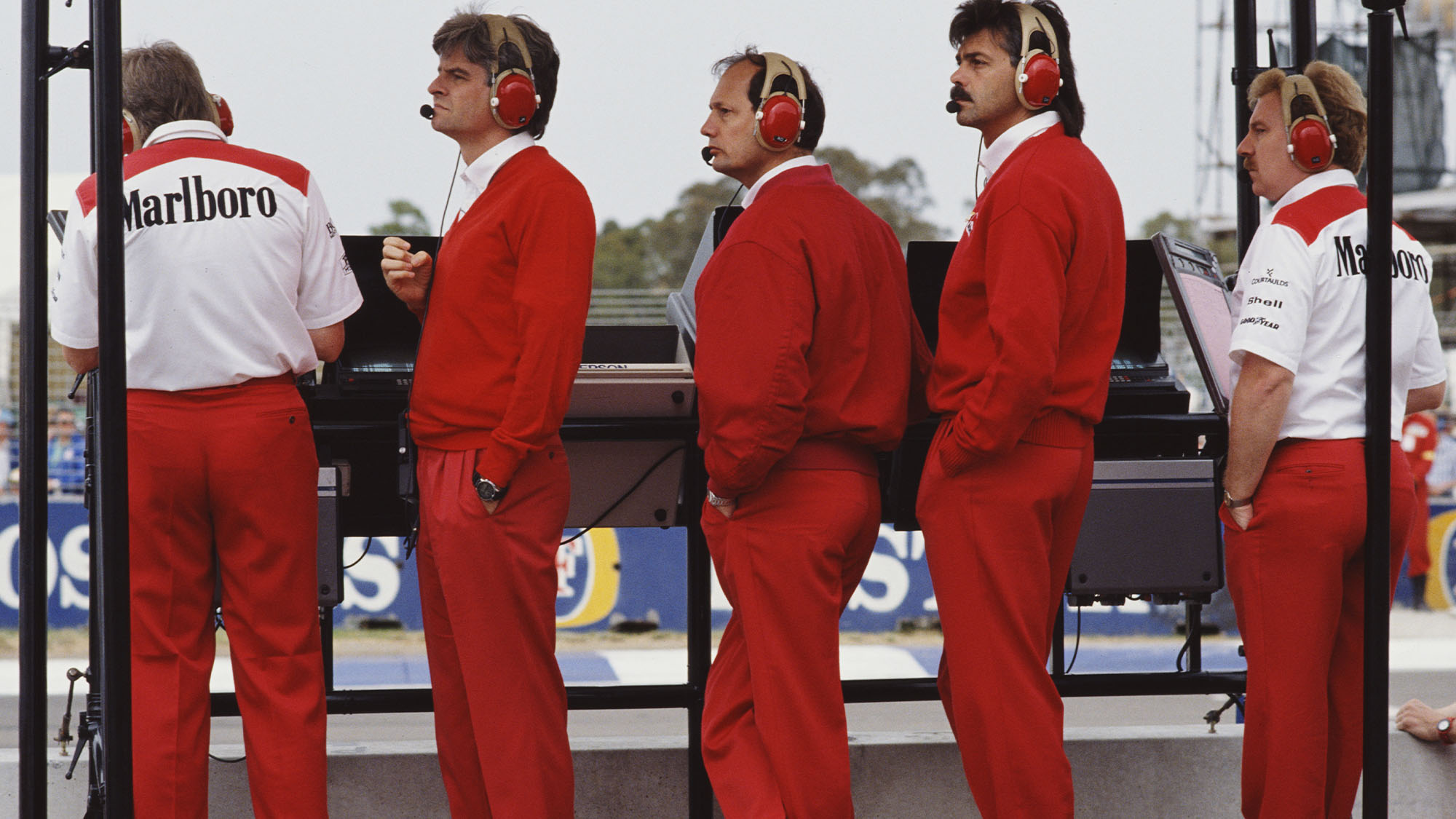 Team principle for Honda Marlboro McLaren Ron Dennis stands in between team designers Steve Nichols (L) and Gordon Murray (R)and Neil Oatley (far right) during the Foster's Australian Grand Prix on 5th November 1989 on the streets of Adelaide in Adelaide, Australia. (Photo by Pascal Rondeau/Getty Images)
