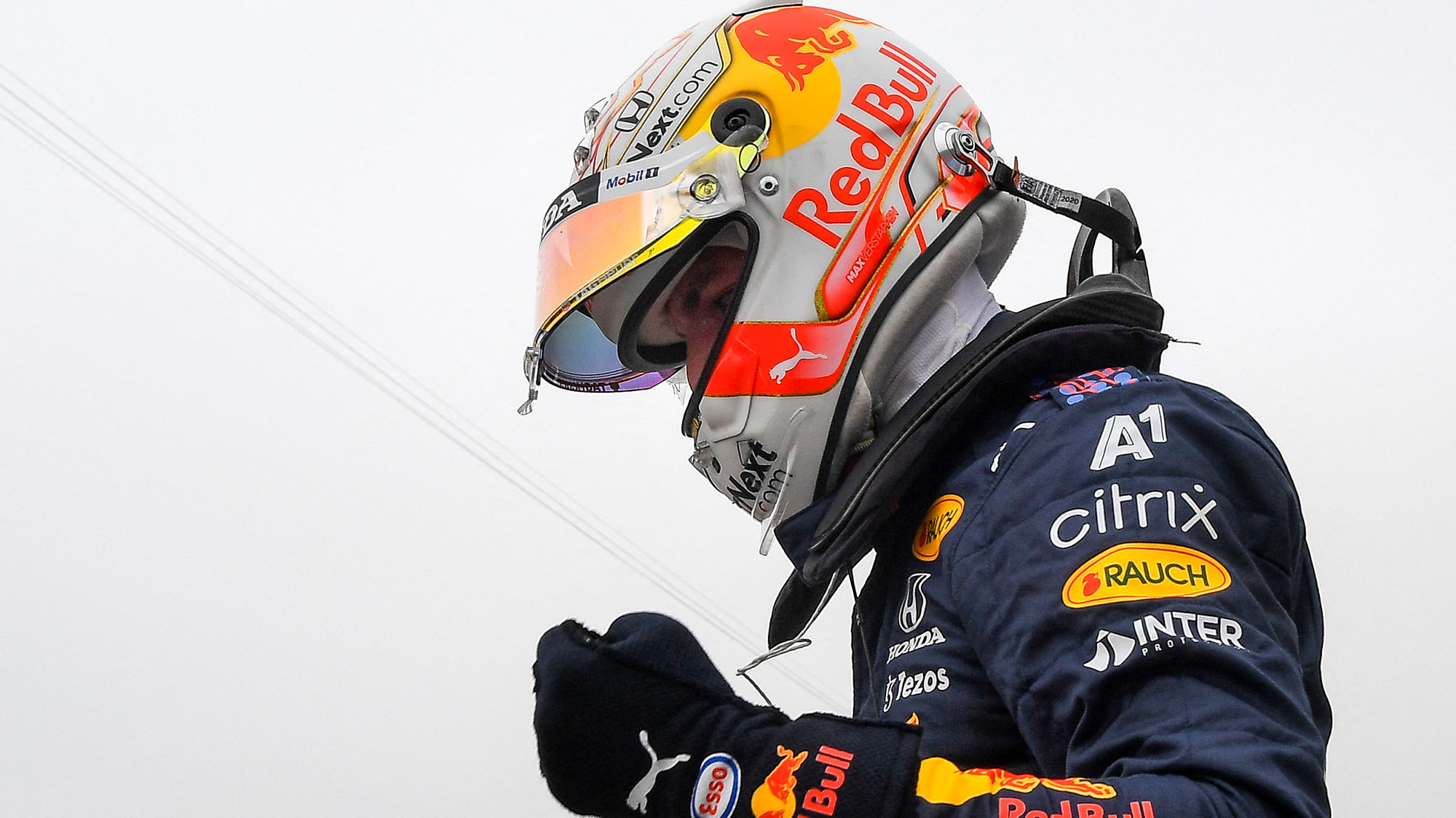 Red Bull's Dutch driver Max Verstappen celebrates in the parc ferme at the end of the qualifying sessions at the Circuit Paul-Ricard in Le Castellet, southern France, on June 19, 2021, ahead of the French Formula One Grand Prix. - Max Verstappen claimed pole on June 19, 2021, for the French Grand Prix with Lewis Hamilton's Mercedes alongside the Red Bull driver on the front row. (Photo by NICOLAS TUCAT / POOL / AFP) (Photo by NICOLAS TUCAT/POOL/AFP via Getty Images)
