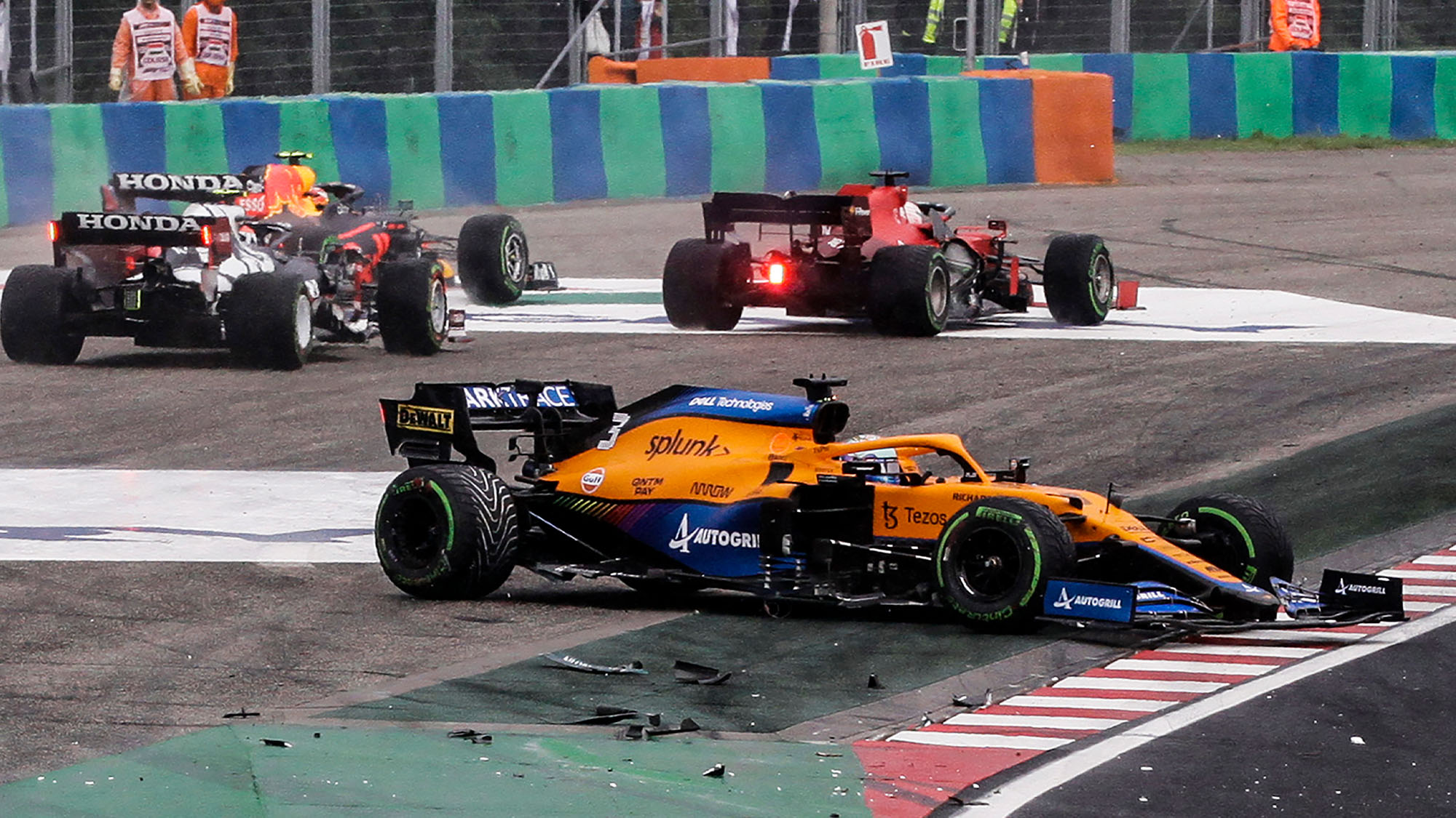 McLaren's Australian driver Daniel Ricciardo stands on the side of the track after his car was involved in a crash at the start of the Formula One Hungarian Grand Prix at the Hungaroring race track in Mogyorod near Budapest on August 1, 2021. (Photo by Peter Kohalmi / AFP) / The erroneous mention[s] appearing in the metadata of this photo by Peter Kohalmi has been modified in AFP systems in the following manner: [McLaren's Australian driver Daniel Ricciardo] instead of [McLaren's British driver Lando Norris]. Please immediately remove the erroneous mention[s] from all your online services and delete it (them) from your servers. If you have been authorized by AFP to distribute it (them) to third parties, please ensure that the same actions are carried out by them. Failure to promptly comply with these instructions will entail liability on your part for any continued or post notification usage. Therefore we thank you very much for all your attention and prompt action. We are sorry for the inconvenience this notification may cause and remain at your disposal for any further information you may require. (Photo by PETER KOHALMI/AFP via Getty Images)