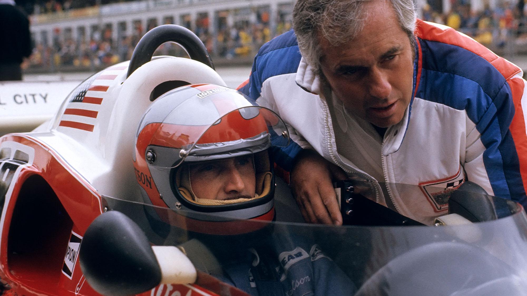 John Watson, Roger Penske, Penske-Ford PC4, Grand Prix of Germany, Nurburgring, 01 August 1976. John Watson with team owner Roger Penske. (Photo by Paul-Henri Cahier /Getty Images)