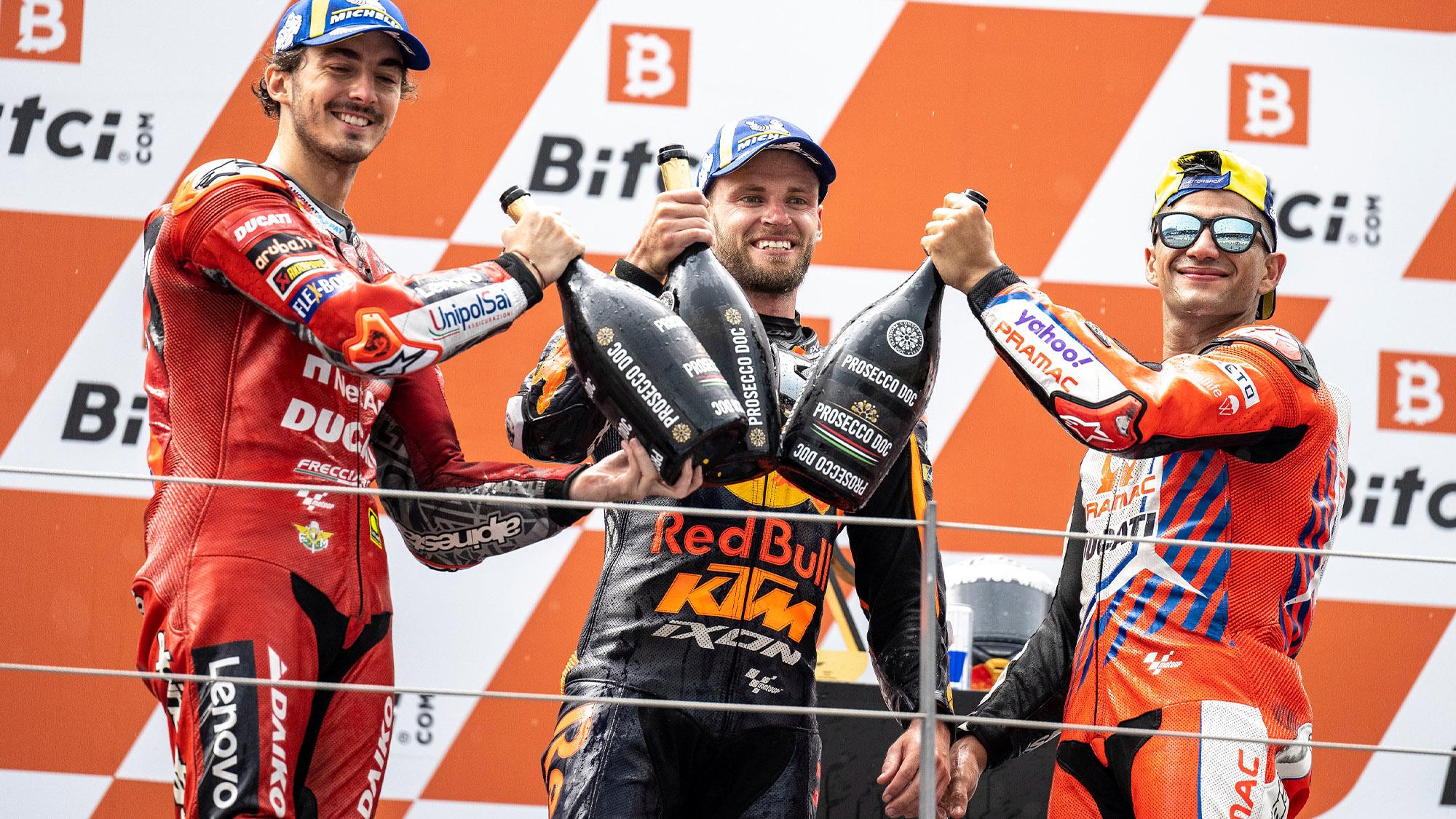 Brad Binder Pecco Bagnaia and Jorge Martin on the pdoum after the 2021 MotoGP Austrian GP