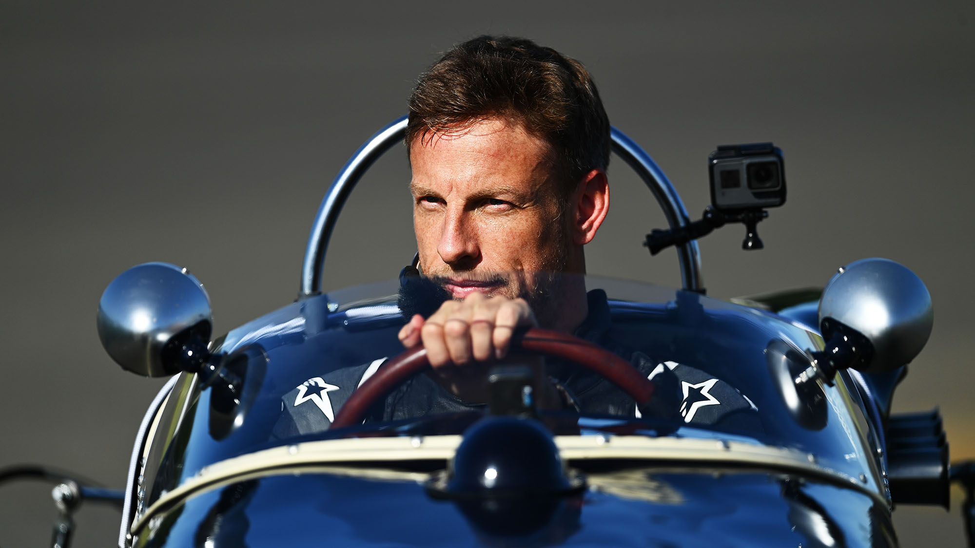 NORTHAMPTON, ENGLAND - AUGUST 07: Jenson Button drives the Lotus 18 of the late Stirling Moss as part of a tribute before practice for the F1 70th Anniversary Grand Prix at Silverstone on August 07, 2020 in Northampton, England. (Photo by Clive Mason - Formula 1/Formula 1 via Getty Images)