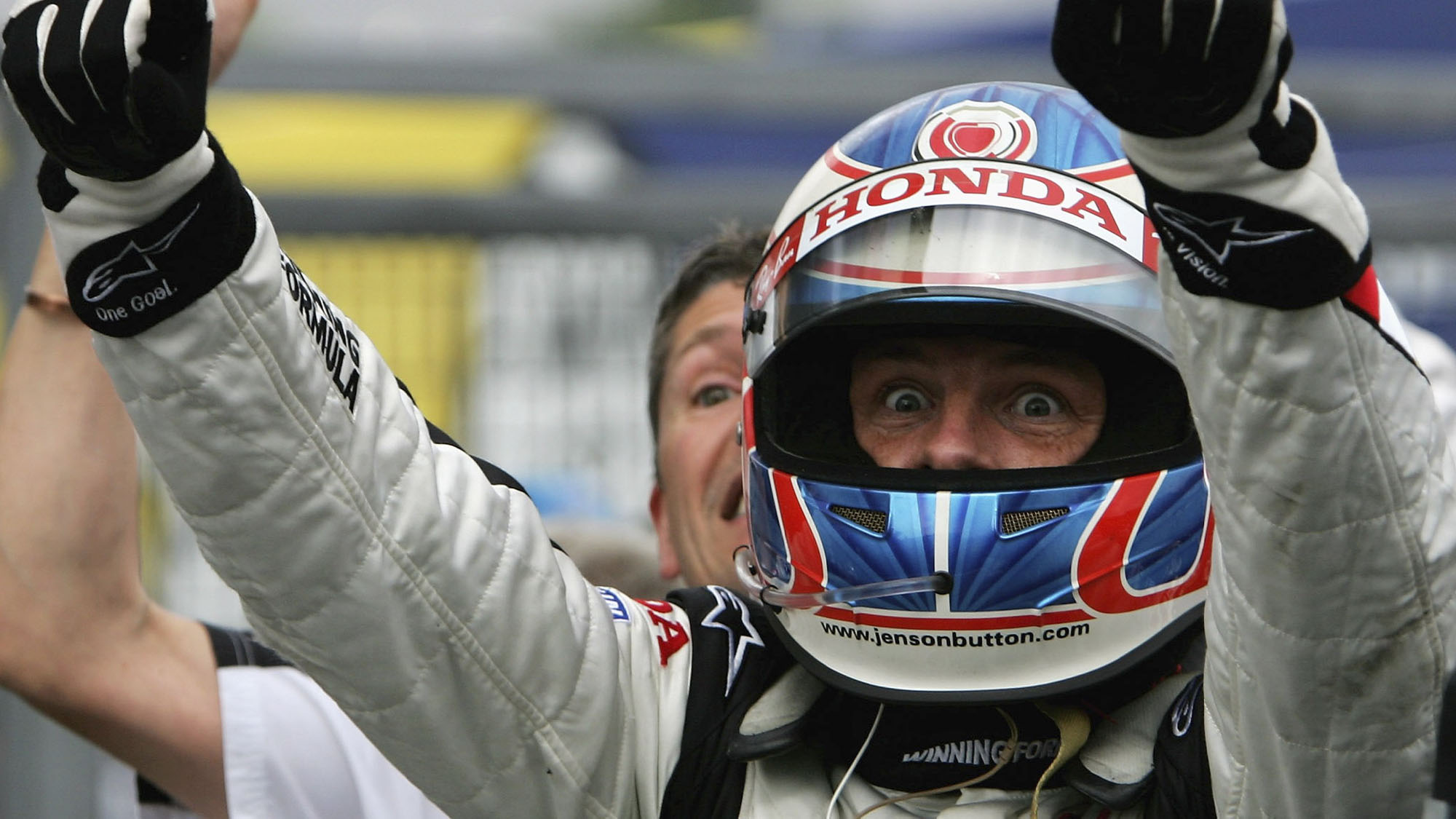 BUDAPEST, HUNGARY - AUGUST 06: Jenson Button of Great Britain and Honda Racing celebrates his first ever Formula One victory after winning the Hungarian Formula One Grand Prix at the Hungaroring on August 6, 2006 in Budapest, Hunagary. (Photo by Paul Gilham/Getty Images)