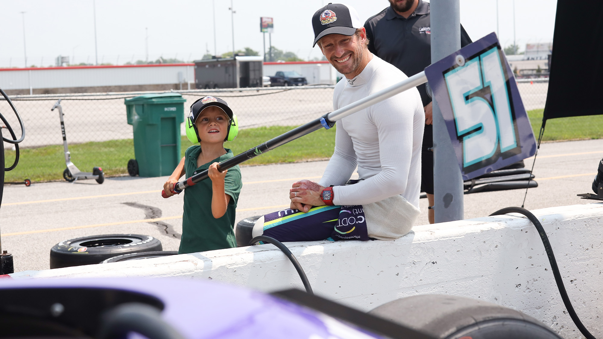 Romain Grosjean with his son at the 2021 Gateway oval test
