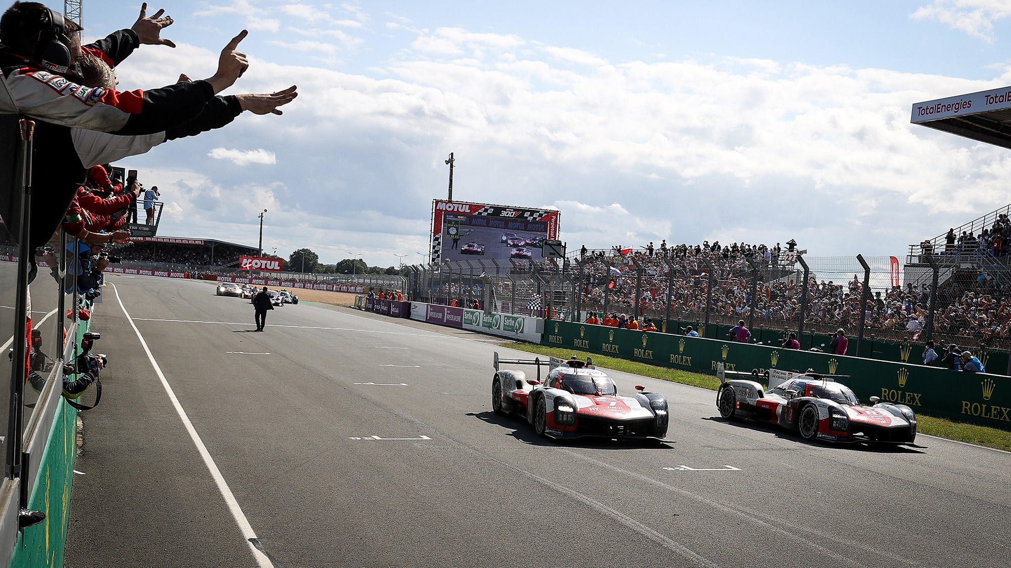Toyotas cross the line to win the 2021 Le Mans 24 Hours