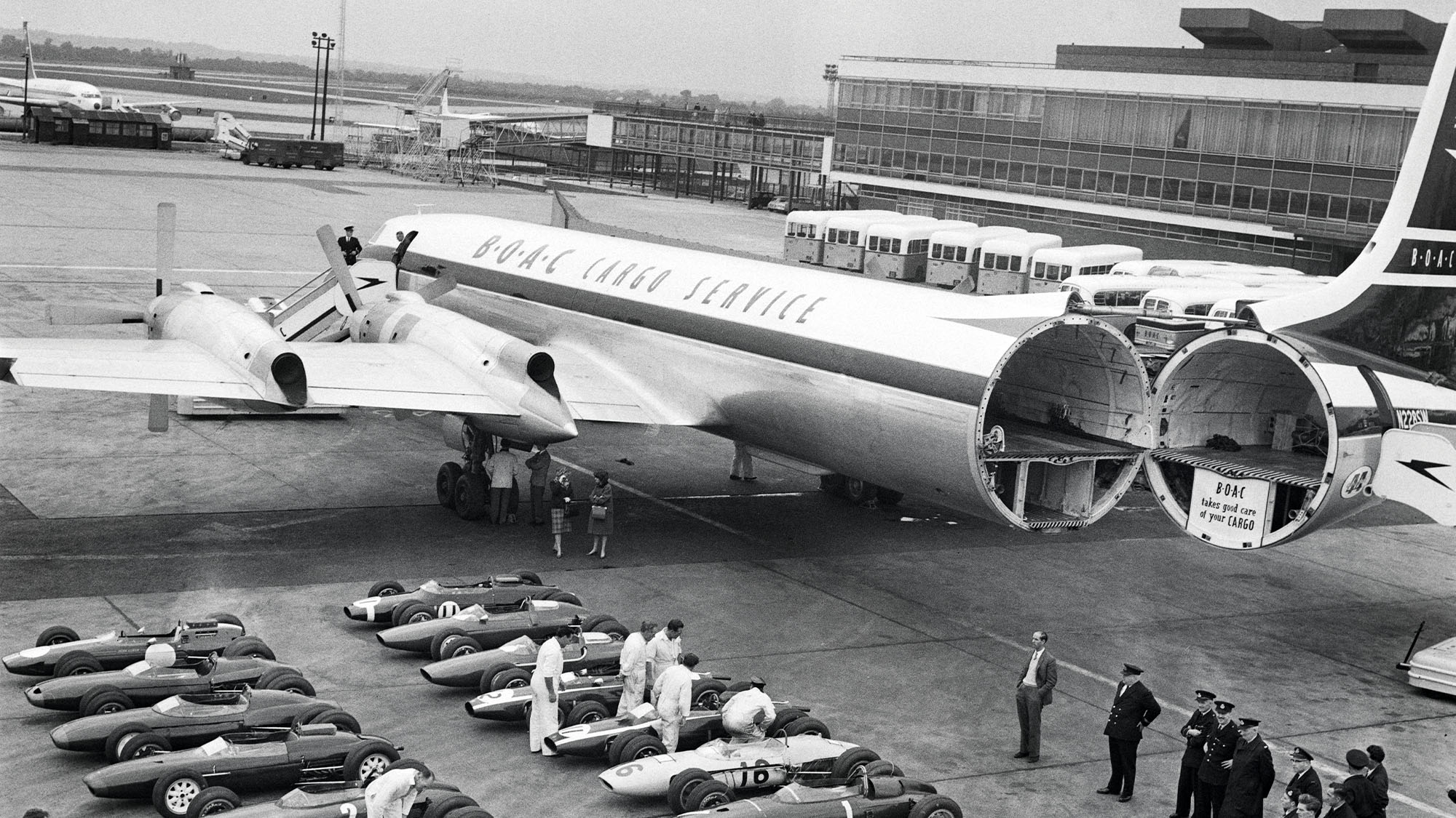 F1 cars wait to be loaded on a plane to the 1963 Watkins Glen race