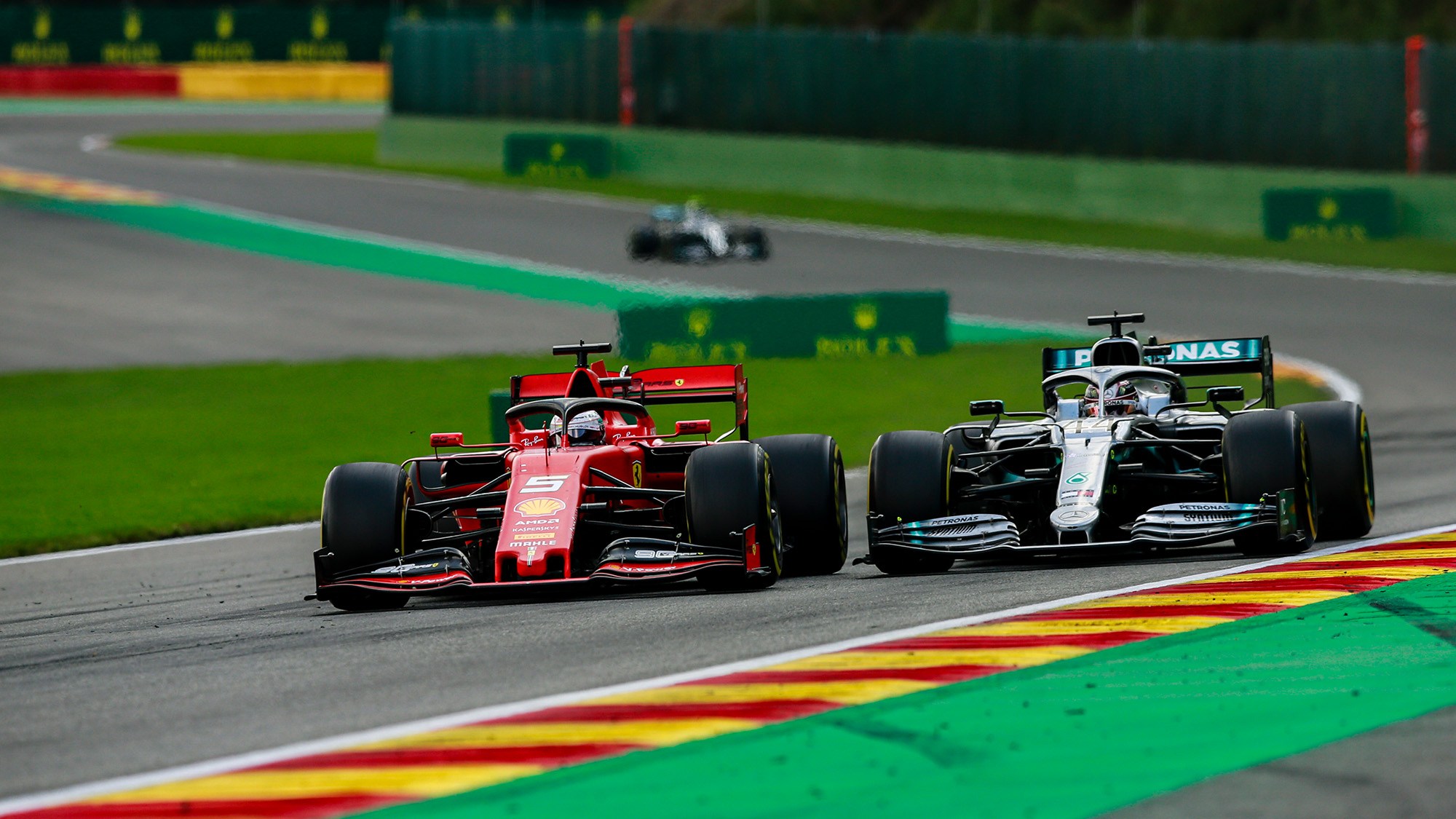 Lewis Hamilton and Sebastian Vettel battle at the 2019 Belgian Grand Prix