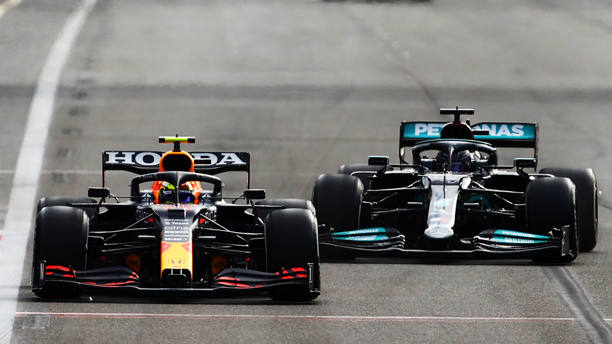 Sergio Perez and Lewis Hamilton battle at the 2021 Azerbaijan Grand Prix