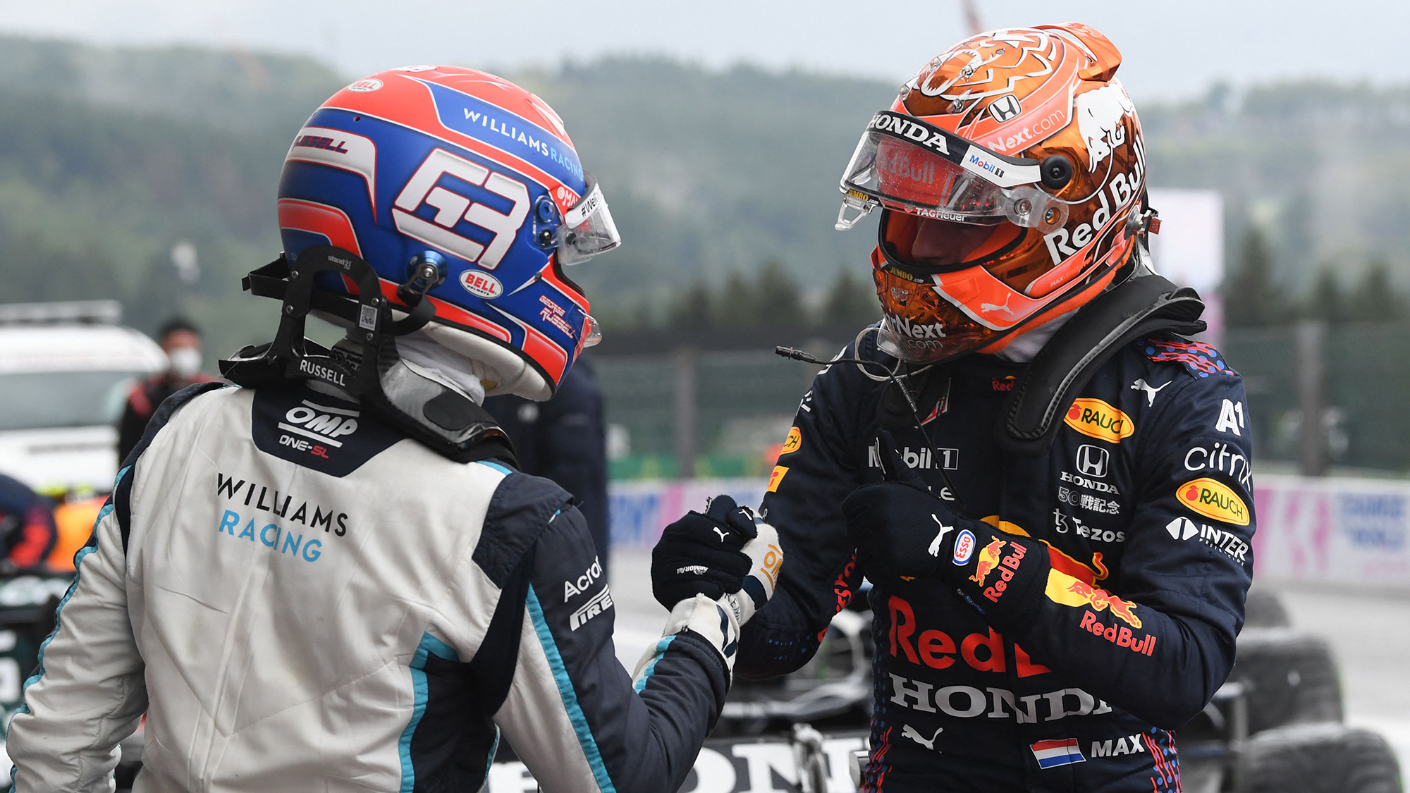 George Russell and Max Verstappen shake hands after 2021 Belgian Grand Prix qualifying