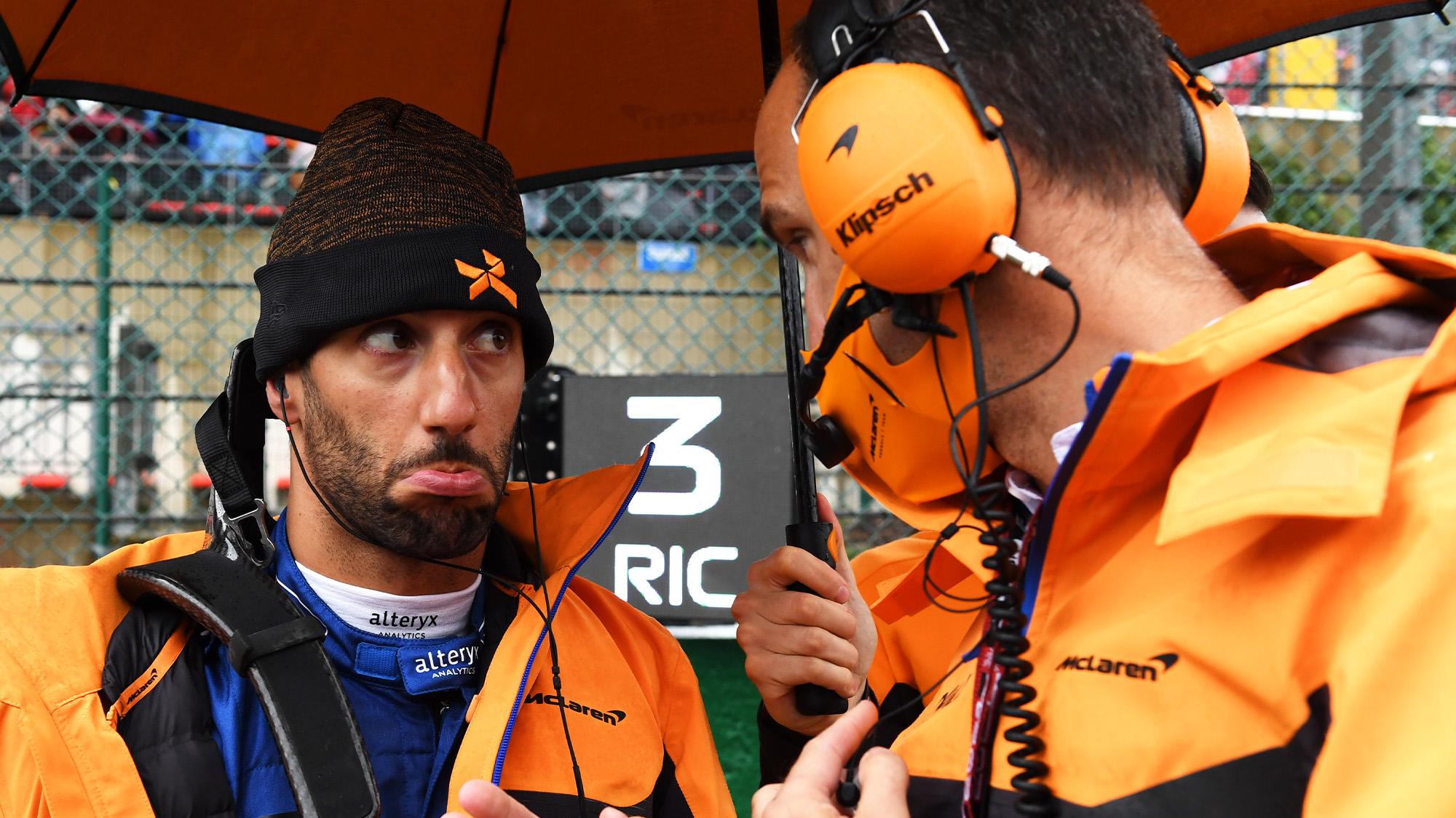 Daniel Ricciardo pokes his bottom lip out during 2021 Belgian Grand Prix rain delay