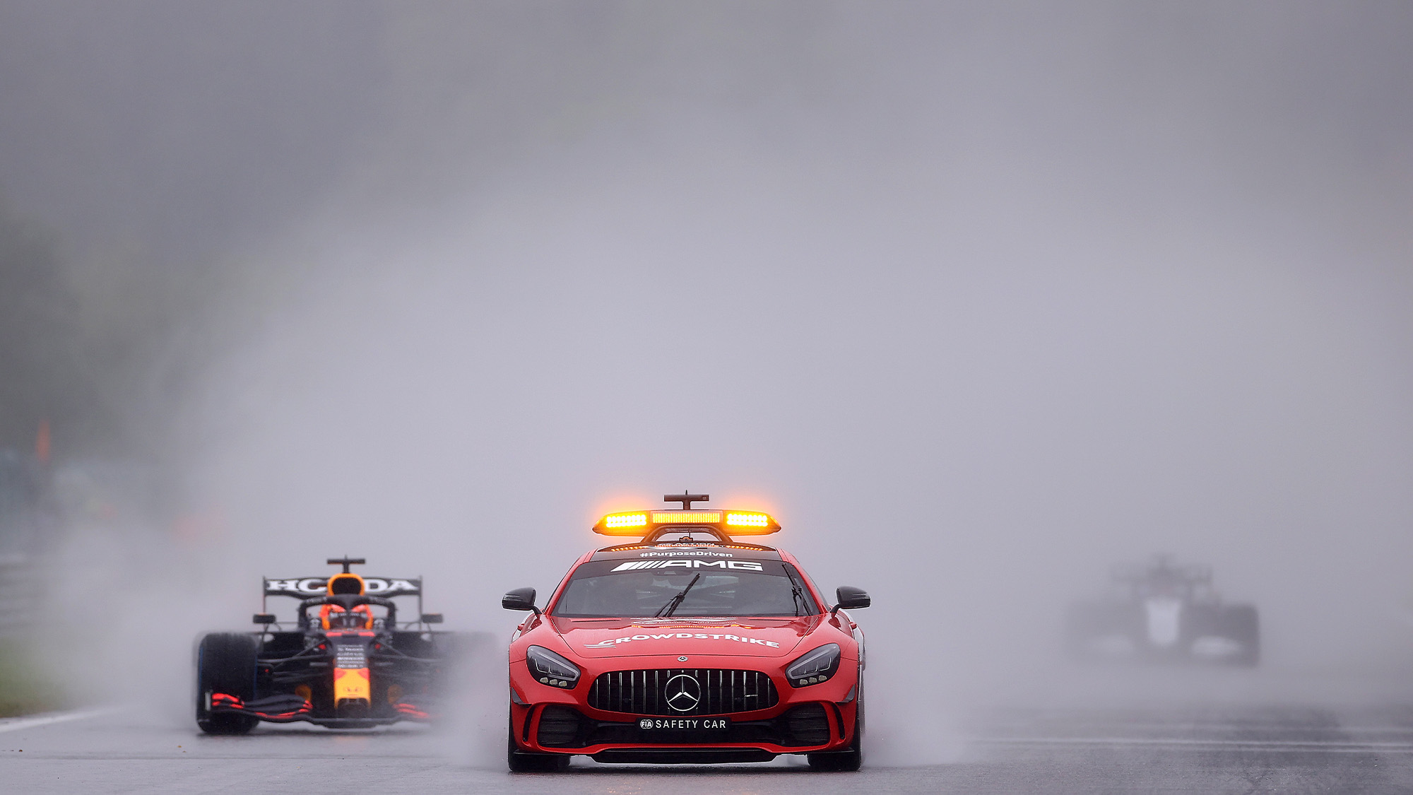 Cars in spray behind safety car at Spa in 2021 Belgian GP