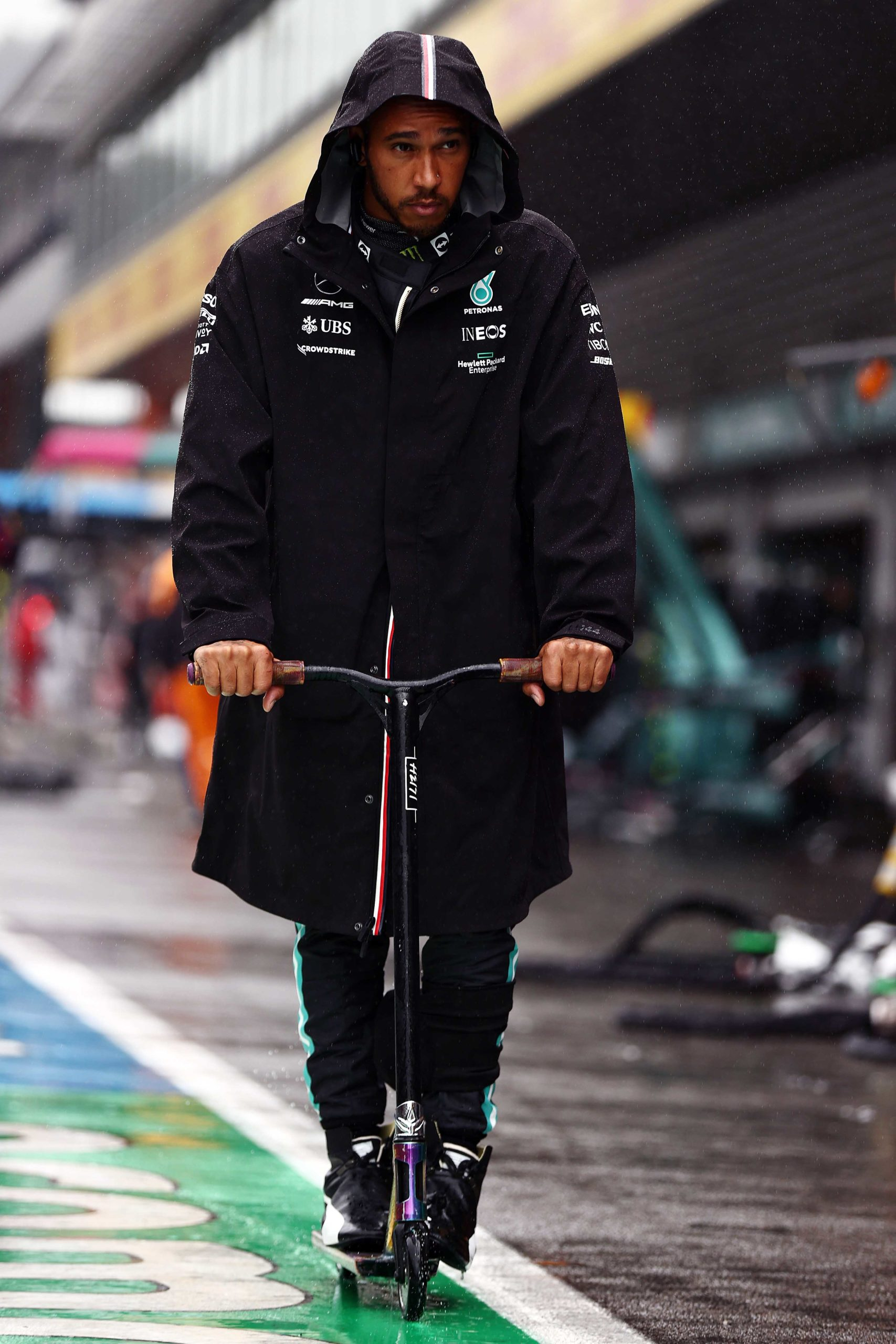 Lewis-Hamilton-on-his-scooter-in-a-wet-Spa-pitlane
