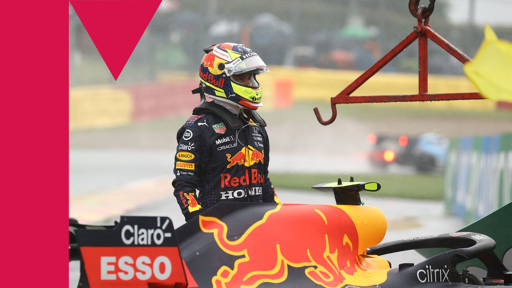 Red Bull's Mexican driver Sergio Perez exits his car after crashing in a warm up run before the Formula One Belgian Grand Prix at the Spa-Francorchamps circuit in Spa on August 29, 2021. (Photo by Kenzo Tribouillard / AFP) (Photo by KENZO TRIBOUILLARD/AFP via Getty Images)