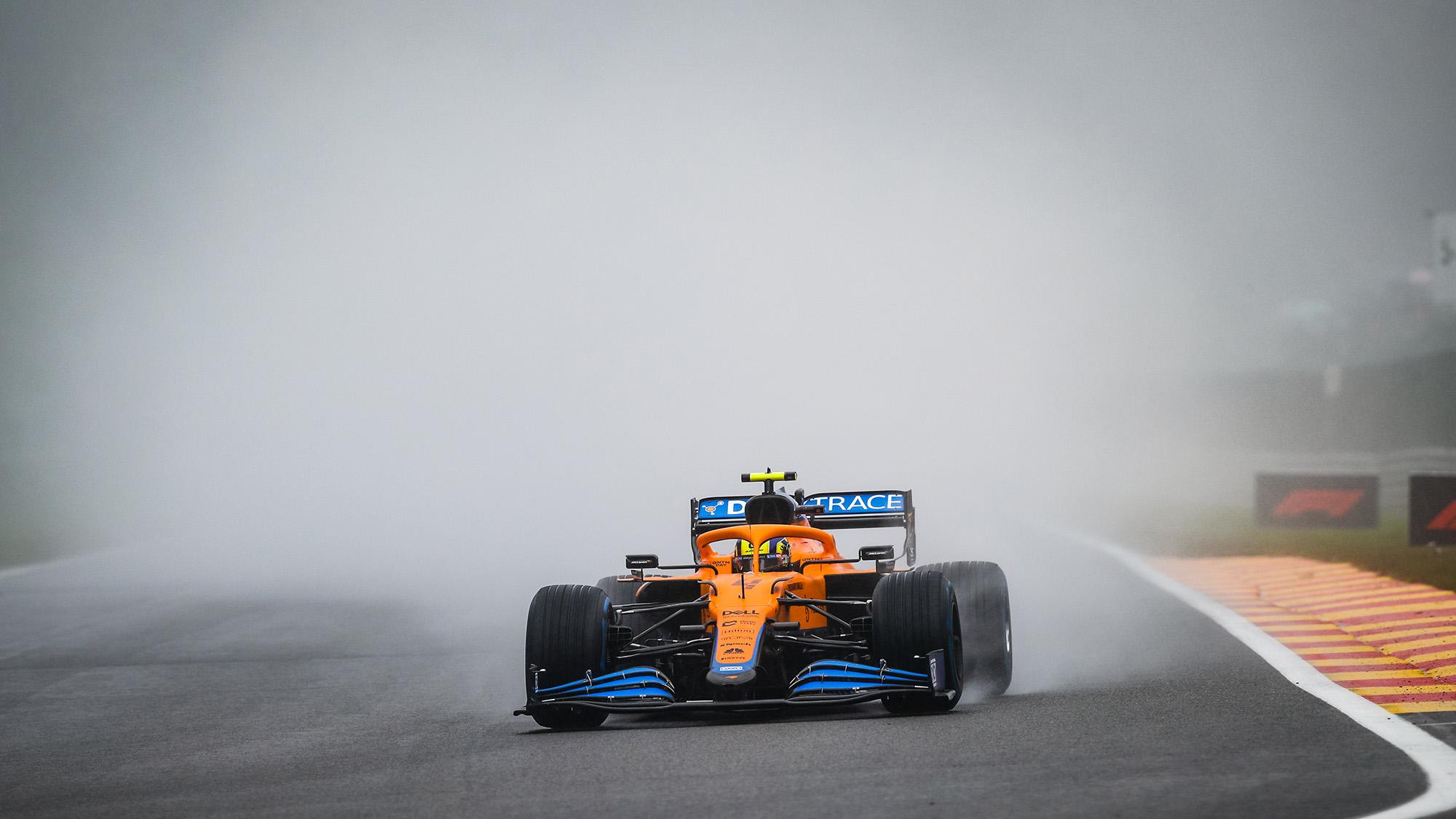 McLaren of Lando Norris generates a cloud of spray at Spa 2021