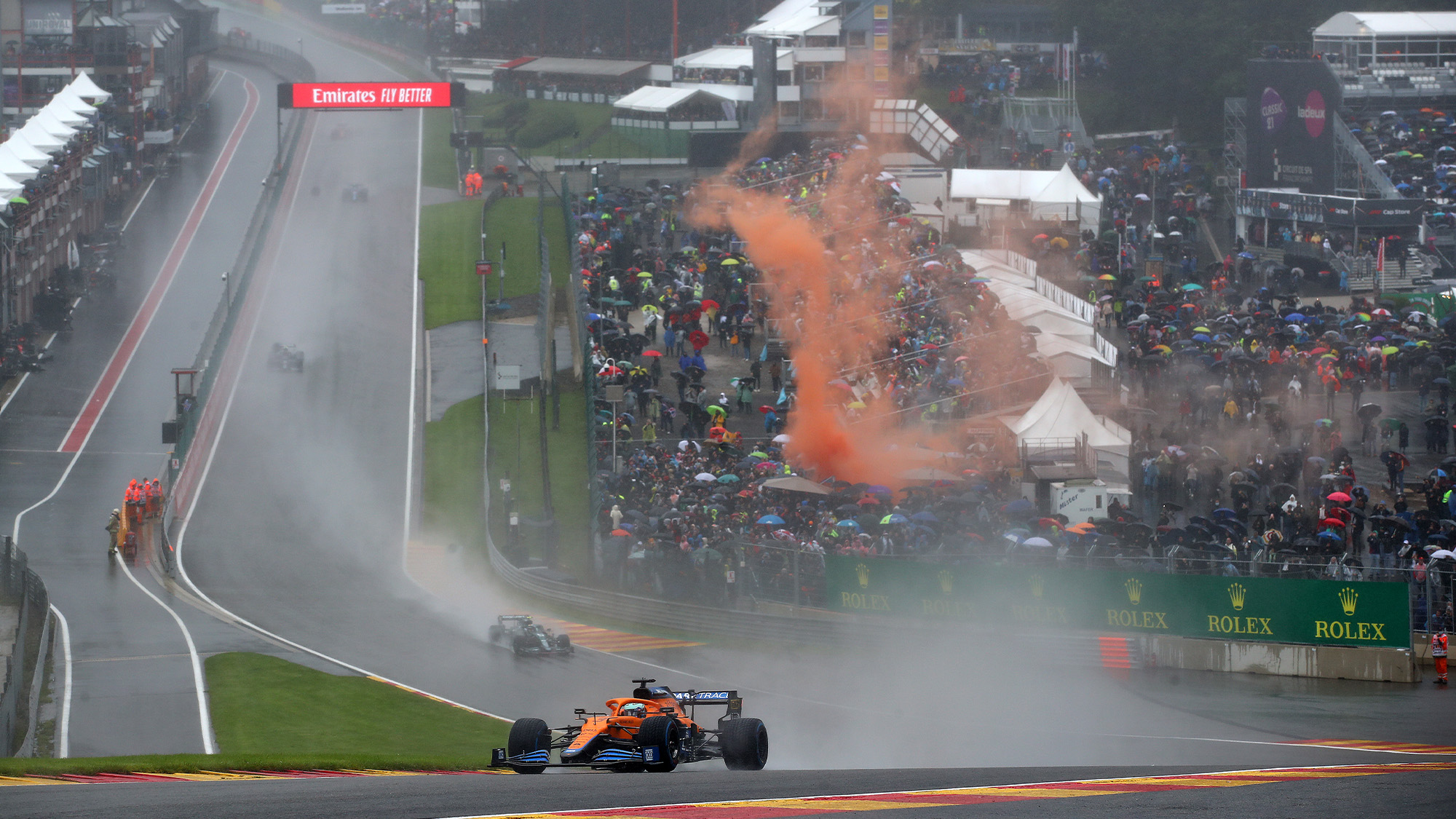 Spray as cars go through Eau Rouge at the 2021 Belgian Grand Prix