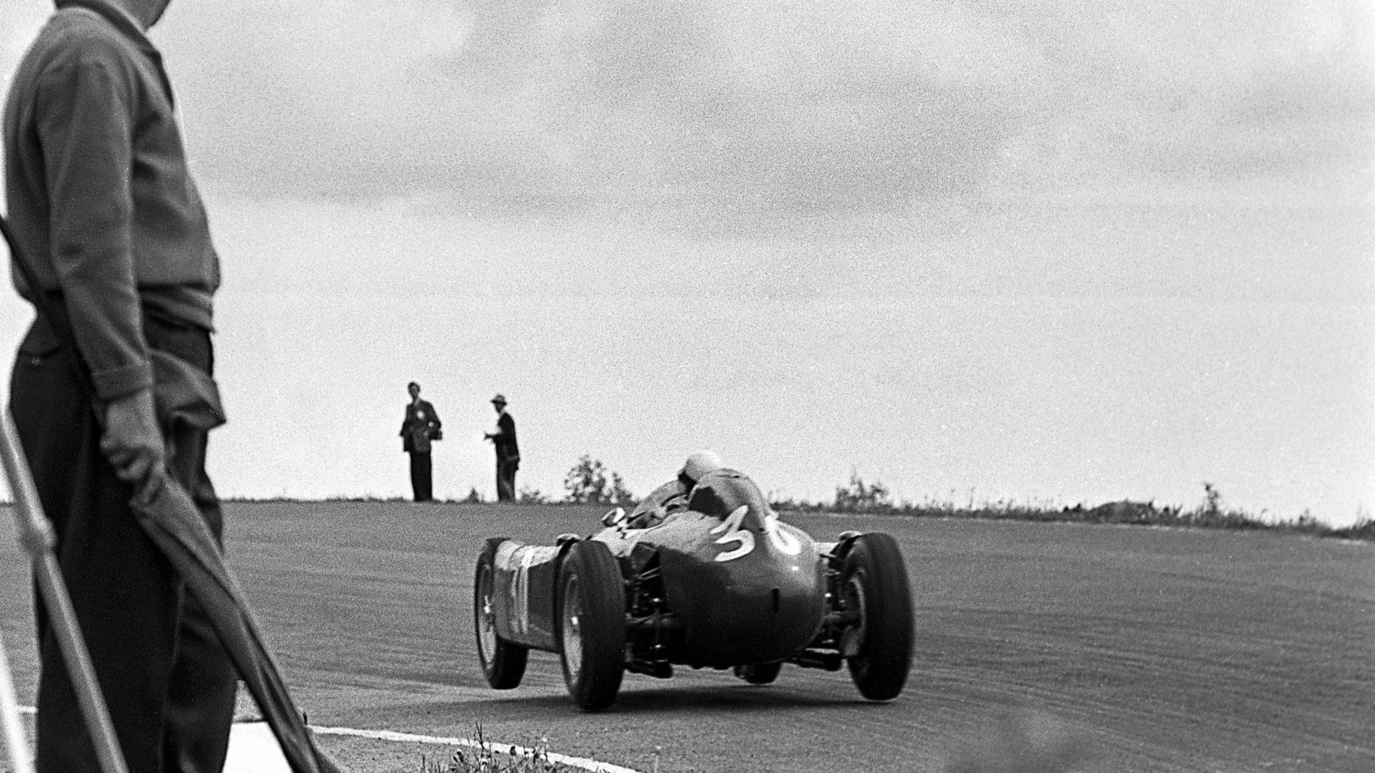 Lancia of Eugenio Castellotti with a wheel off the ground