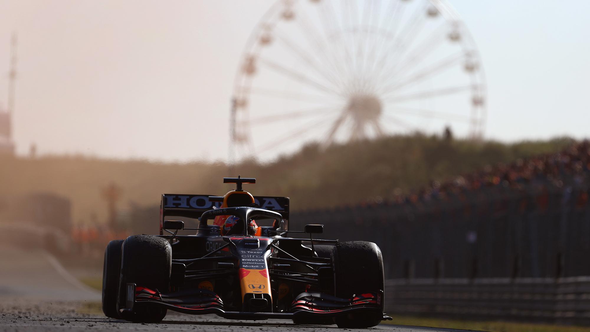 Max Verstappen drives through orange flare smoke at the 2021 Dutch GP