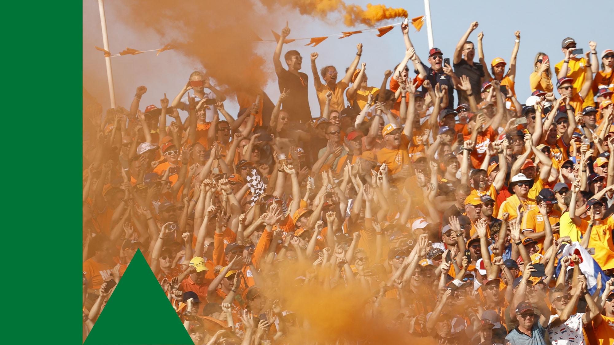 ZANDVOORT- Fans celebrate after the Dutch Grand Prix won by Max Verstappen at the Zandvoort circuit. ANP VINCENT JANNINK (Photo by ANP Sport via Getty Images)