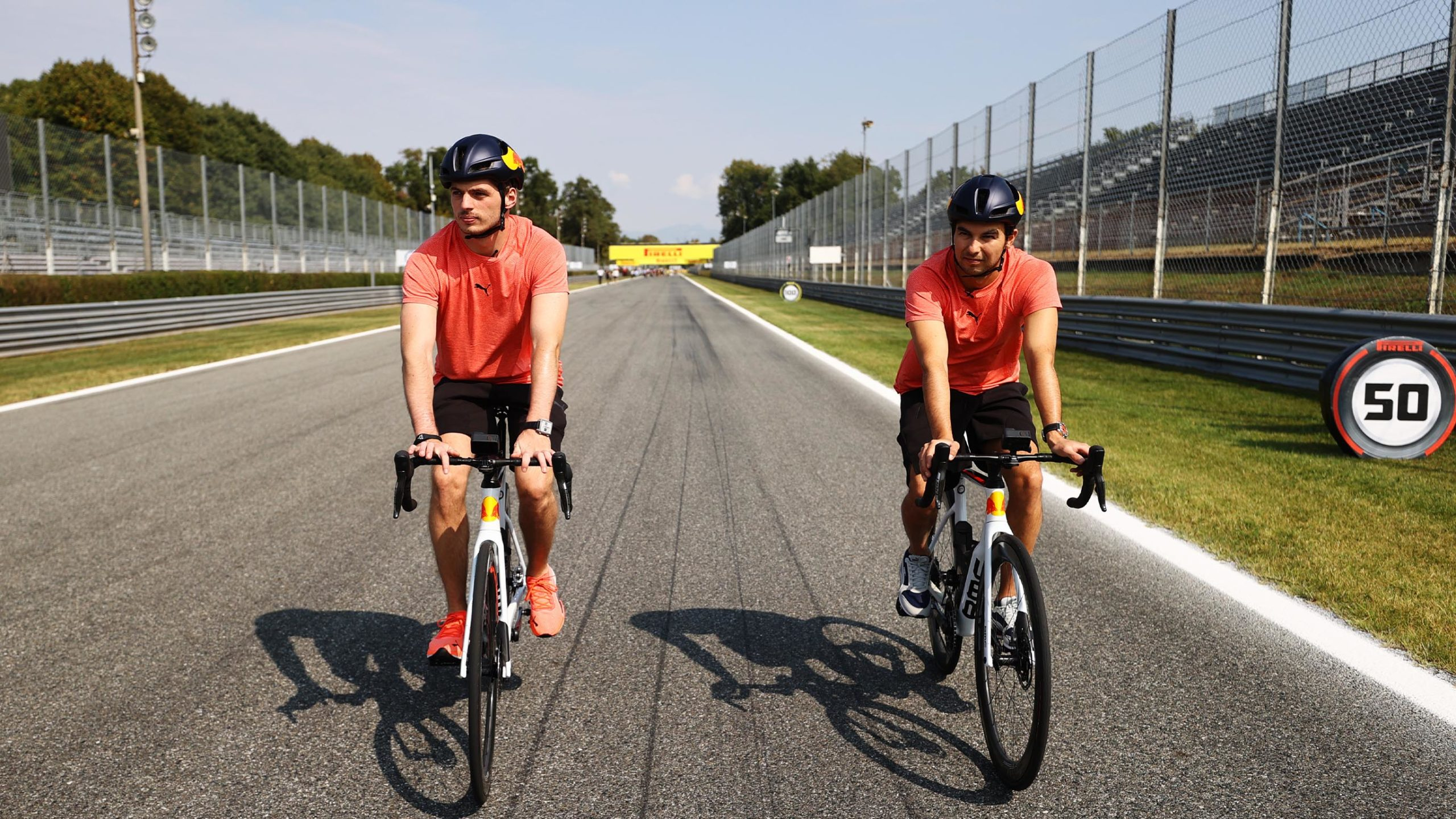 Max Verstappen and Sergio Perez cycling at Monza