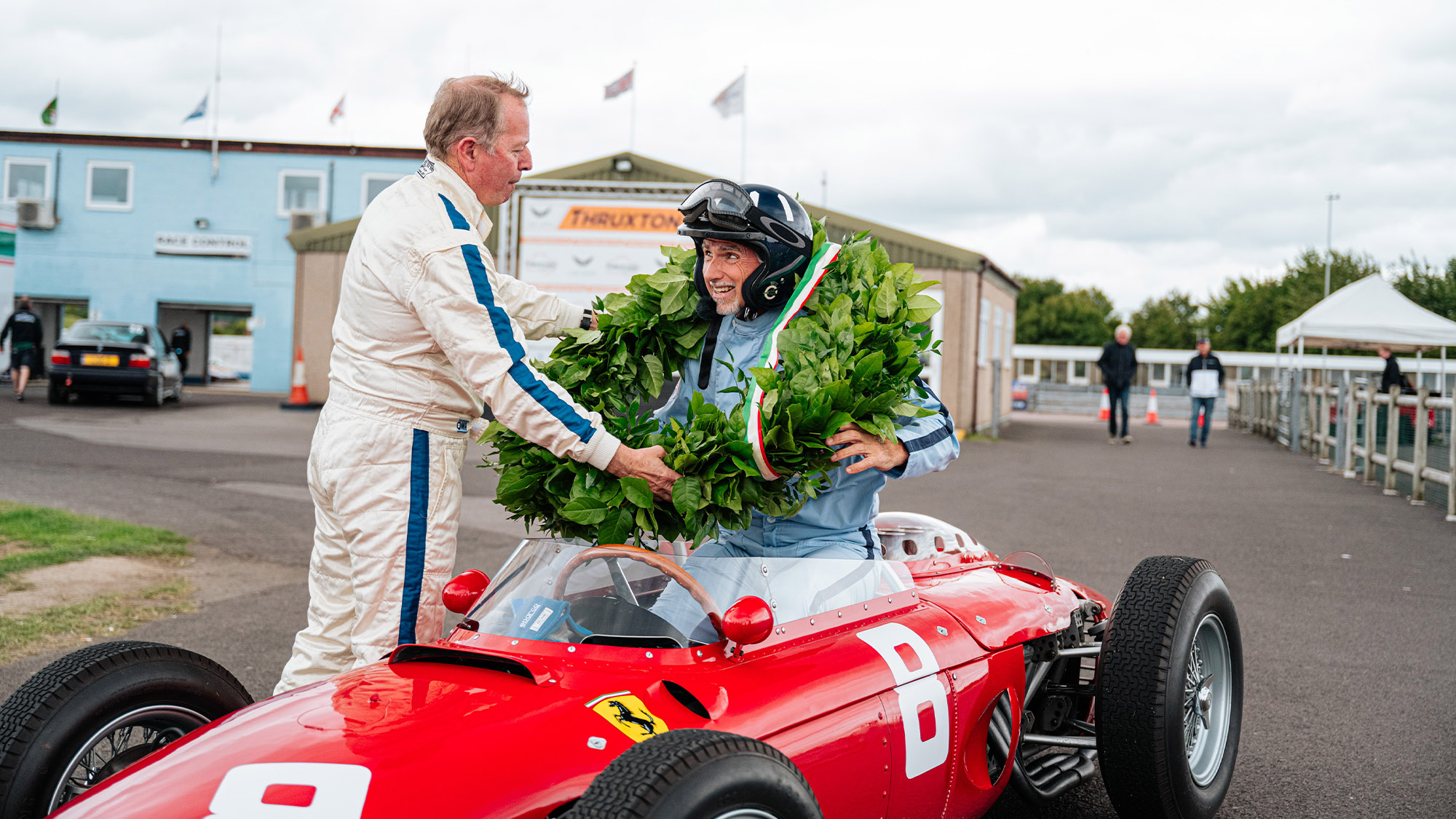 Damon Hill wears garland with Ferrari Sharknose and Martin Brundle