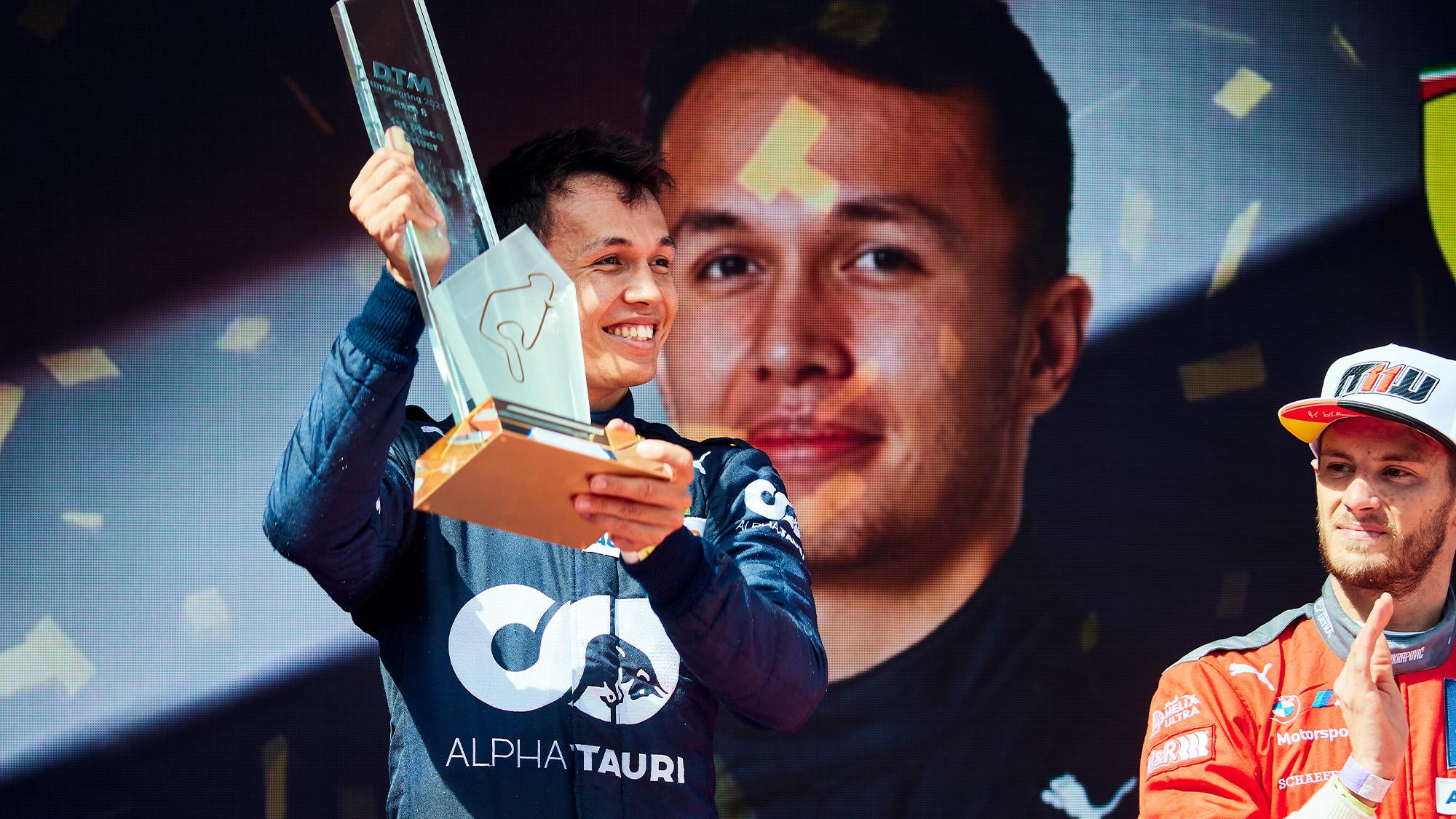 Alex Albon celebrates DTM win