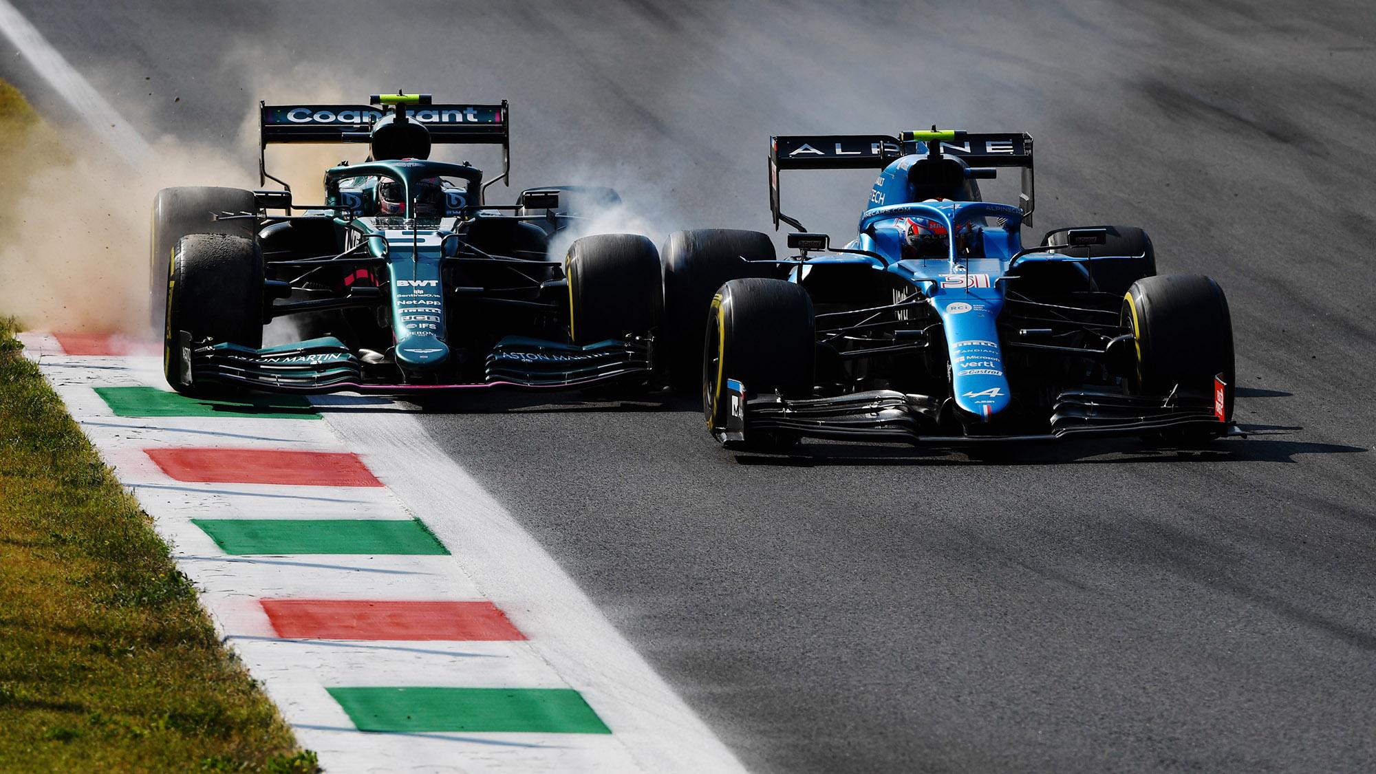 Sebastian Vettel locks up next to Esteban ocon at monza