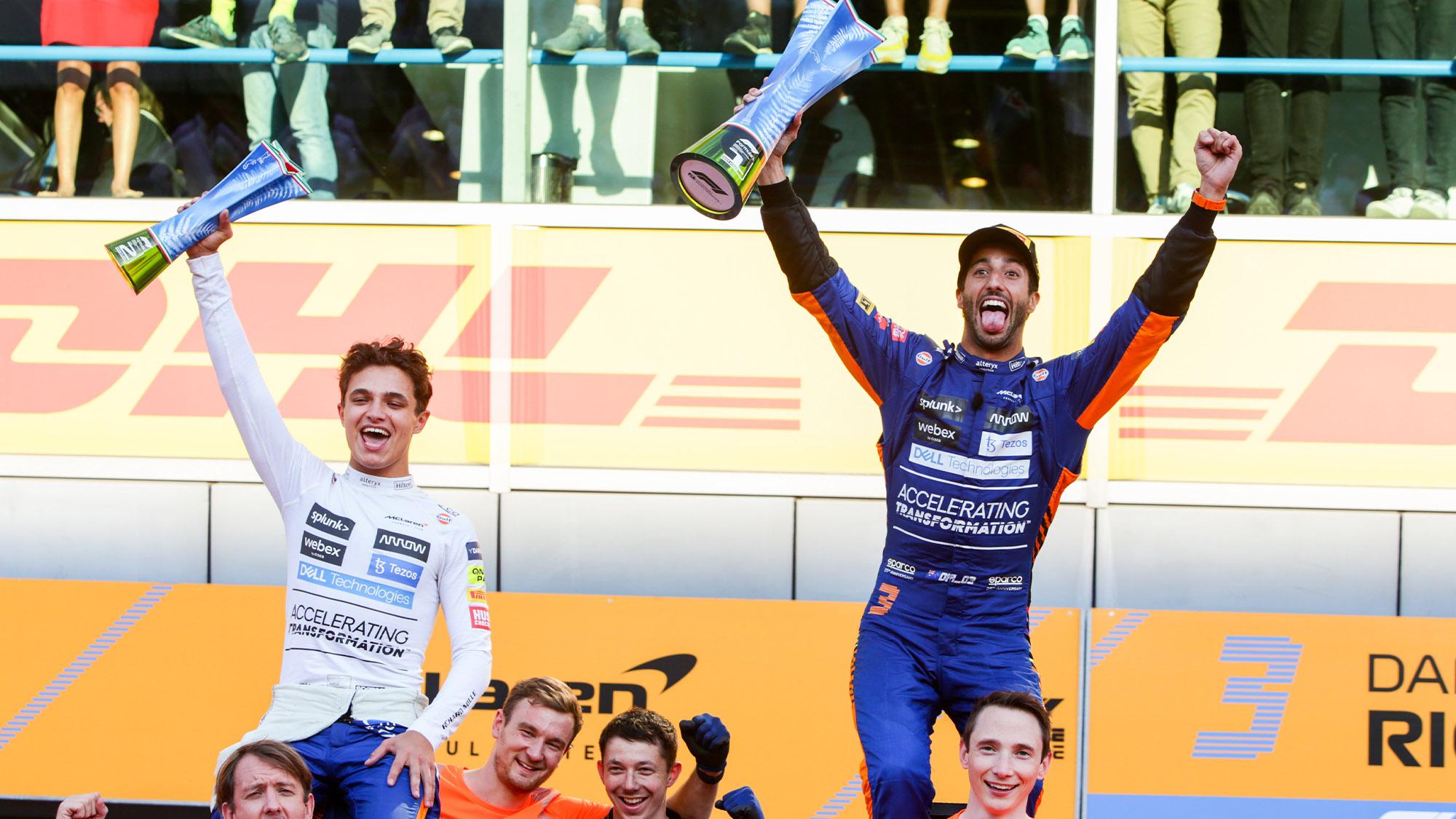 Lando Norris and Daniel Ricciardo celebrate with trophies at Monza