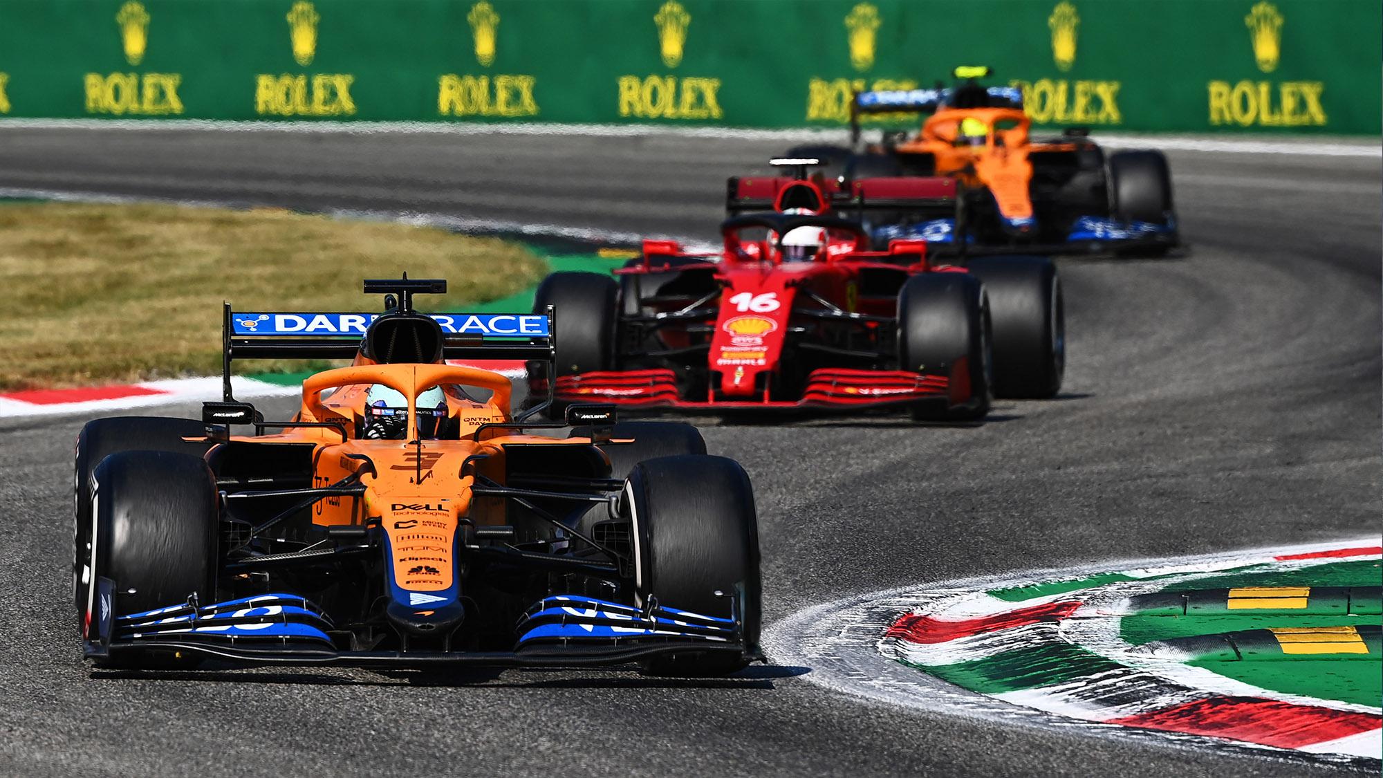 Charles Leclerc between mcLarens in the 2021 italian Grand Prix