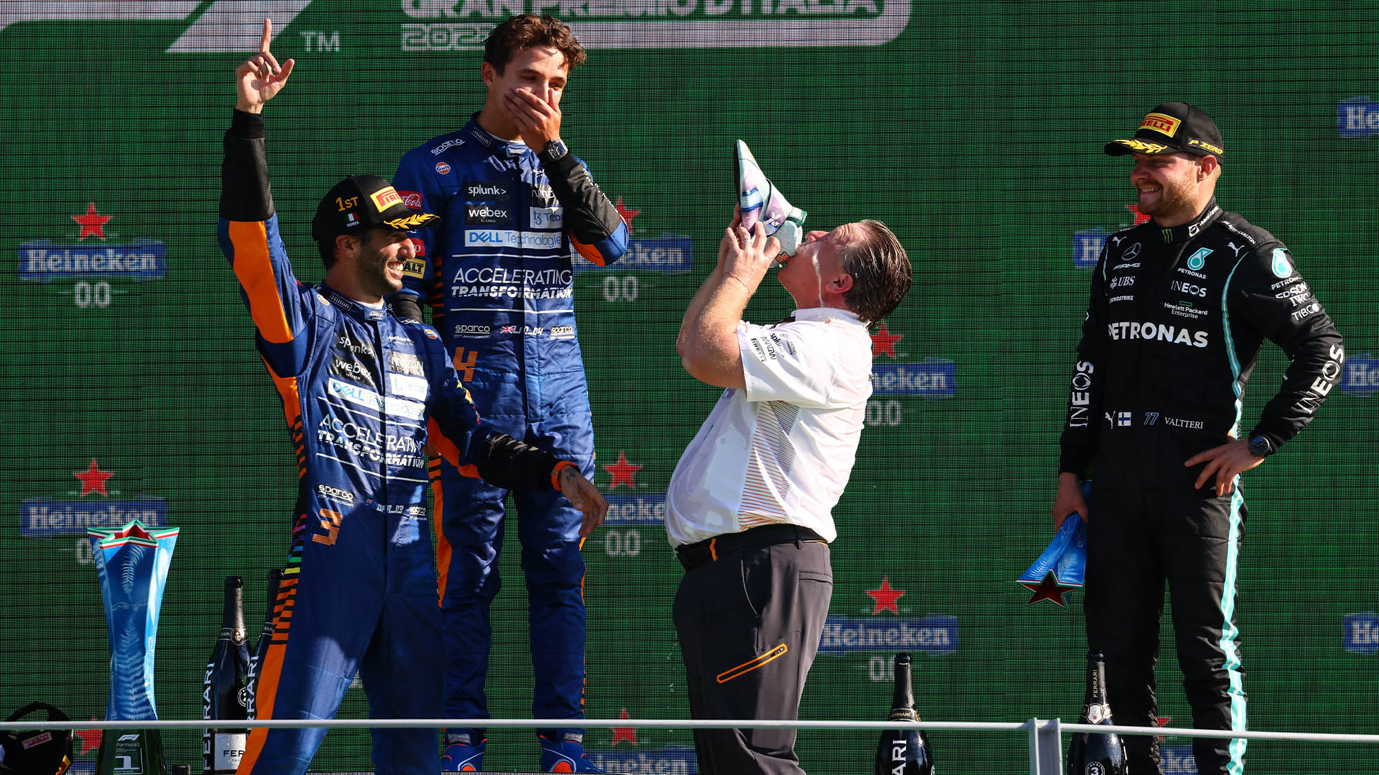 Zak Brown drinks from Daniel Ricciardo's shoe on the Monza podium