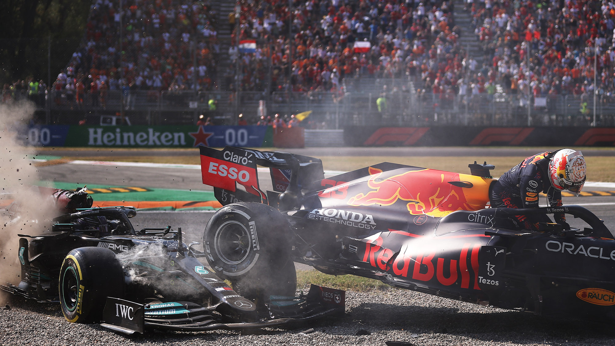 Max Verstappen climbs out of his Reb Bull after Hamilton Monza crash